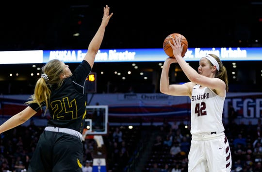 Strafford Lady Indian Hayley Frank shoots a three pointer over Trenton Lady Bulldog Sidney Lynch in the semifinal round during Class 3 state basketball at JQH Arena on Thursday, March 7, 2019. The Indians beat the Bulldogs 63-33.