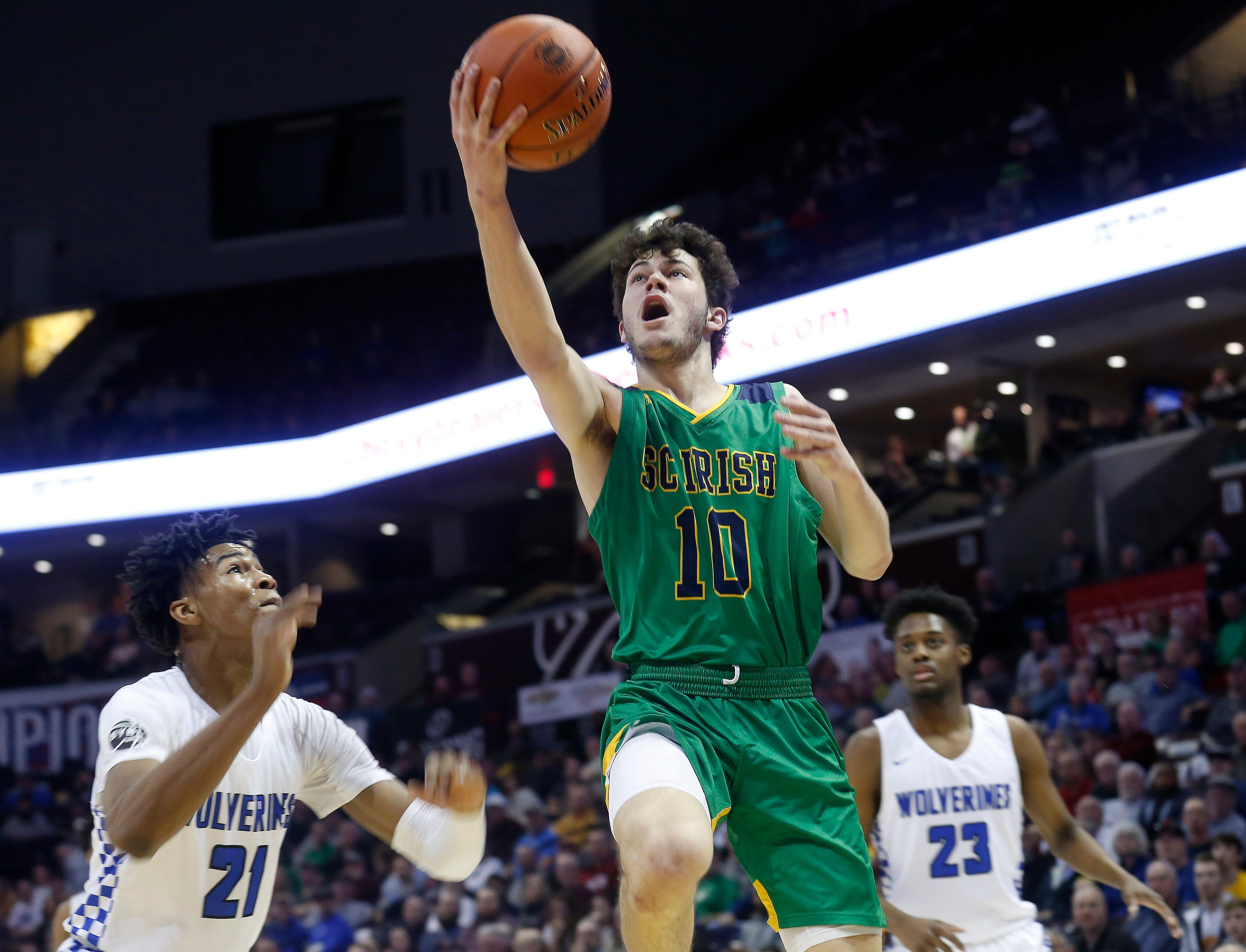 Michael Manzardo, of Springfield Catholic, puts up a shot during the Irish's 69-59 loss to Vashon in the Class 3 state championship game at JQH Arena on Friday, March 8, 2019.