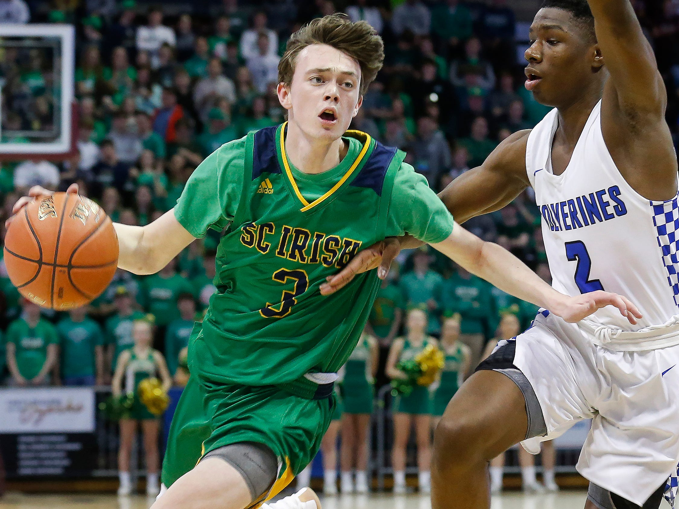 Jake Branham, of Springfield Catholic, brings the ball down the court during the Irish's 69-59 loss to Vashon in the Class 3 state championship game at JQH Arena on Friday, March 8, 2019.