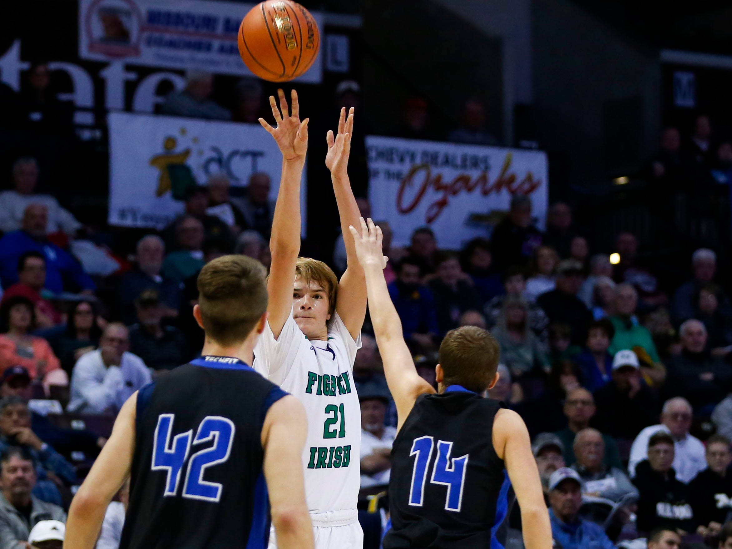 Springfield Catholic's Charlie O'Reilly shoots a three-pointer over St. Paul Lutheran's Justin Griffith during the semifinal round of Class 3 state basketball at JQH Arena on Thursday, March 7, 2019.