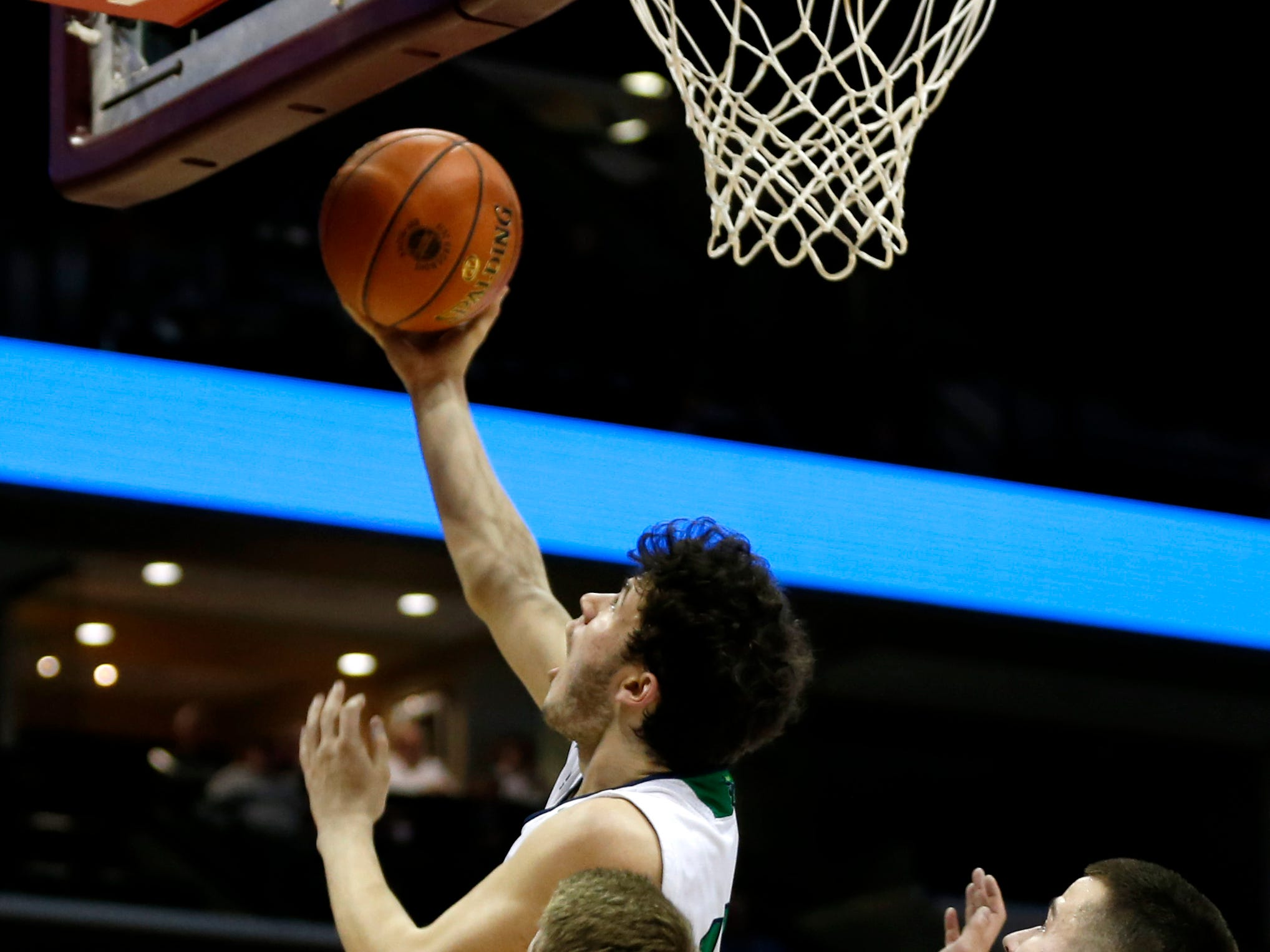 The Springfield Catholic Fightin' Irish take on the St. Paul Lutheran Saints in the semifinal round of Class 3 state basketball at JQH Arena on Thursday, March 7, 2019