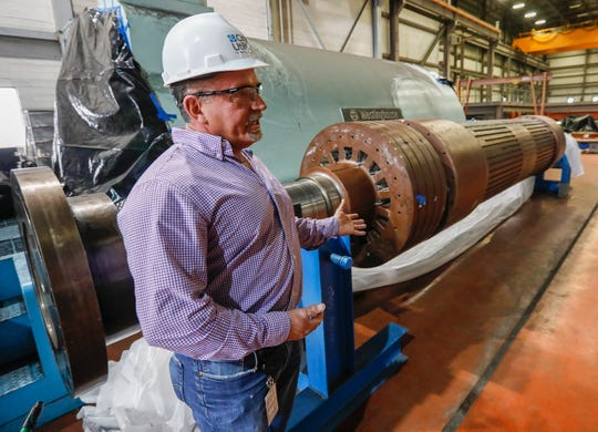 Willy Haffecke, director of power generation at the John Twitty Energy Center, talks about the damage caused to the rotor due to high winds.