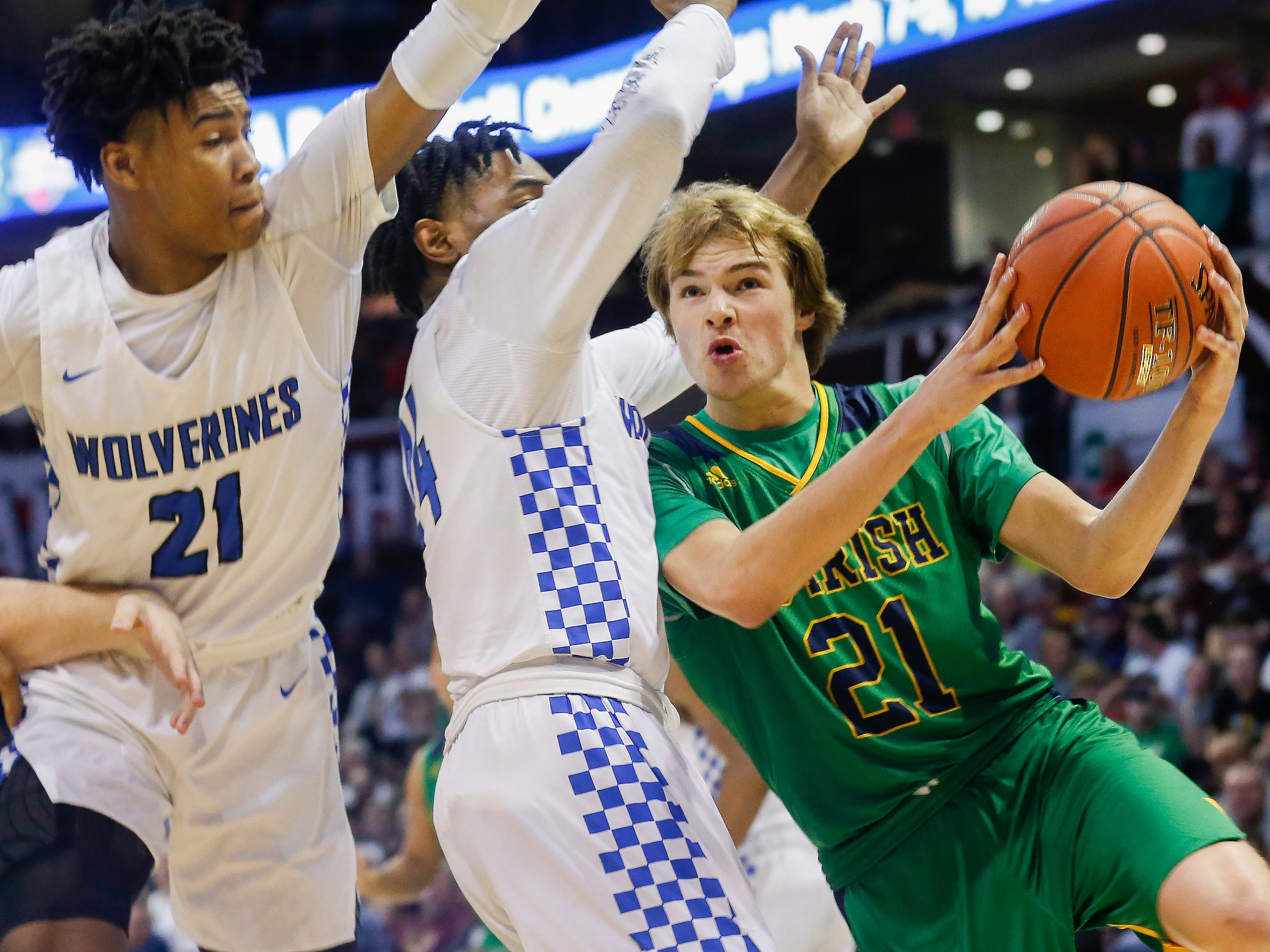 Charlie O'Reilly, of Springfield Catholic, puts up a shot during the Irish's 69-59 loss to Vashon in the Class 3 state championship game at JQH Arena on Friday, March 8, 2019.