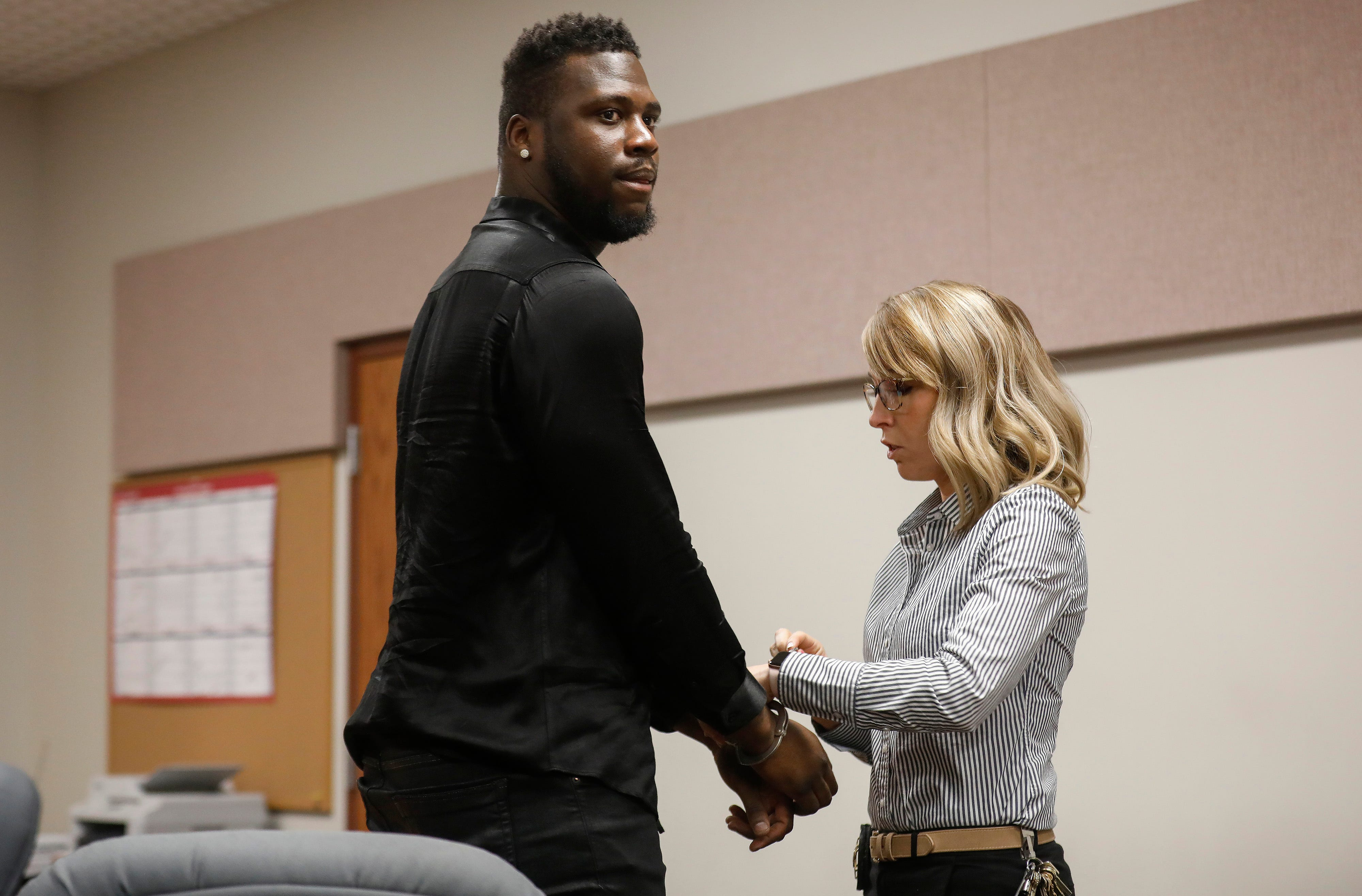 Dorial Green-Beckham is handcuffed by a bailiff after he was sentenced to 90 days in jail for probation violation in a prior DWI case on Friday, March 8, 2019.