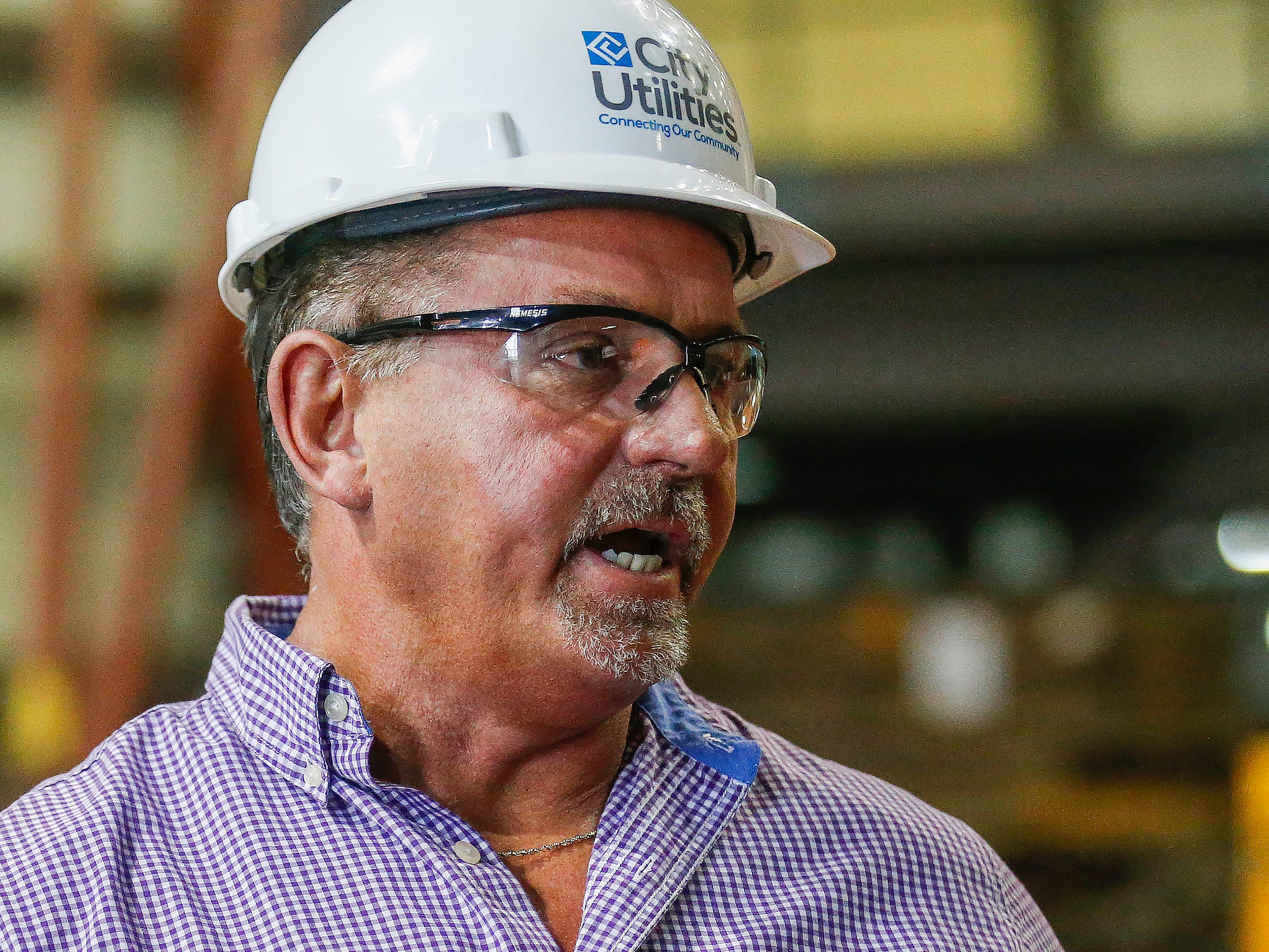 Willy Haffecke, director of power generation at the John Twitty Energy Center, talks about the damage caused to the rotor near the turbine due to high winds.