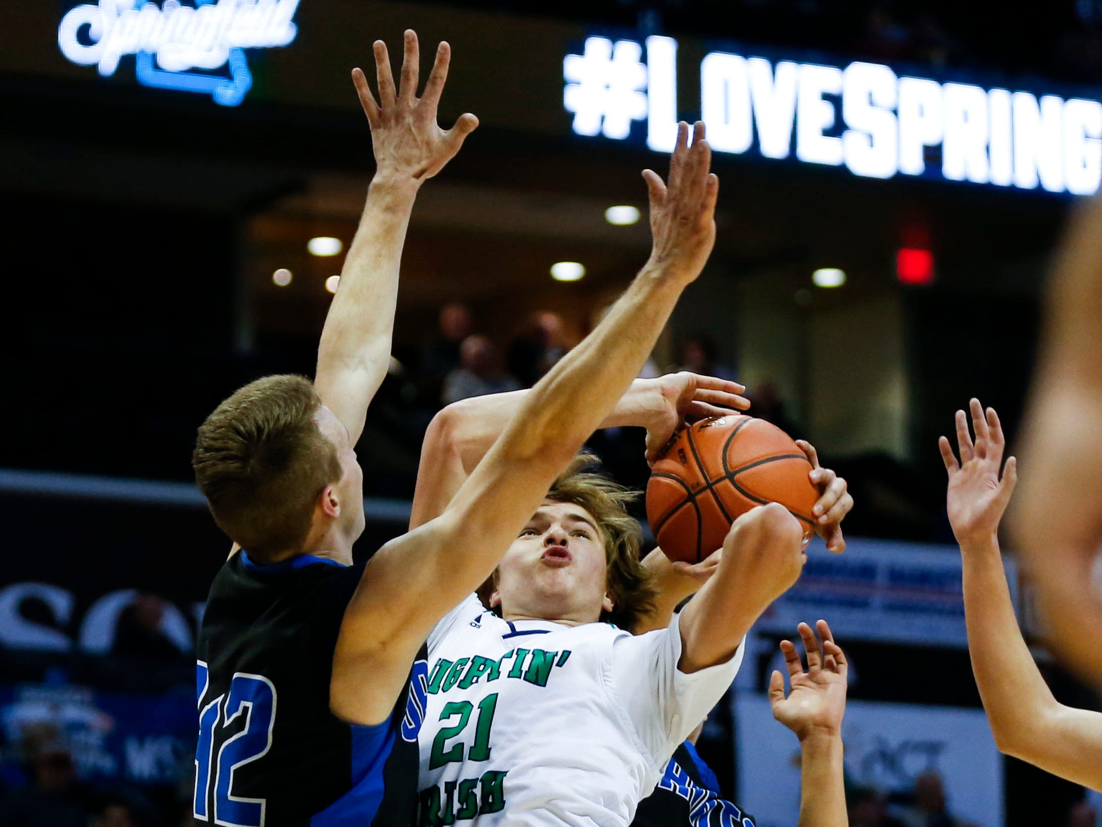 Springfield Catholic's Charlie O'Reilly puts up a field goal over St. Paul Lutheran's Elijah Muehler in the semifinal round of Class 3 state basketball at JQH Arena on Thursday, March 7, 2019.