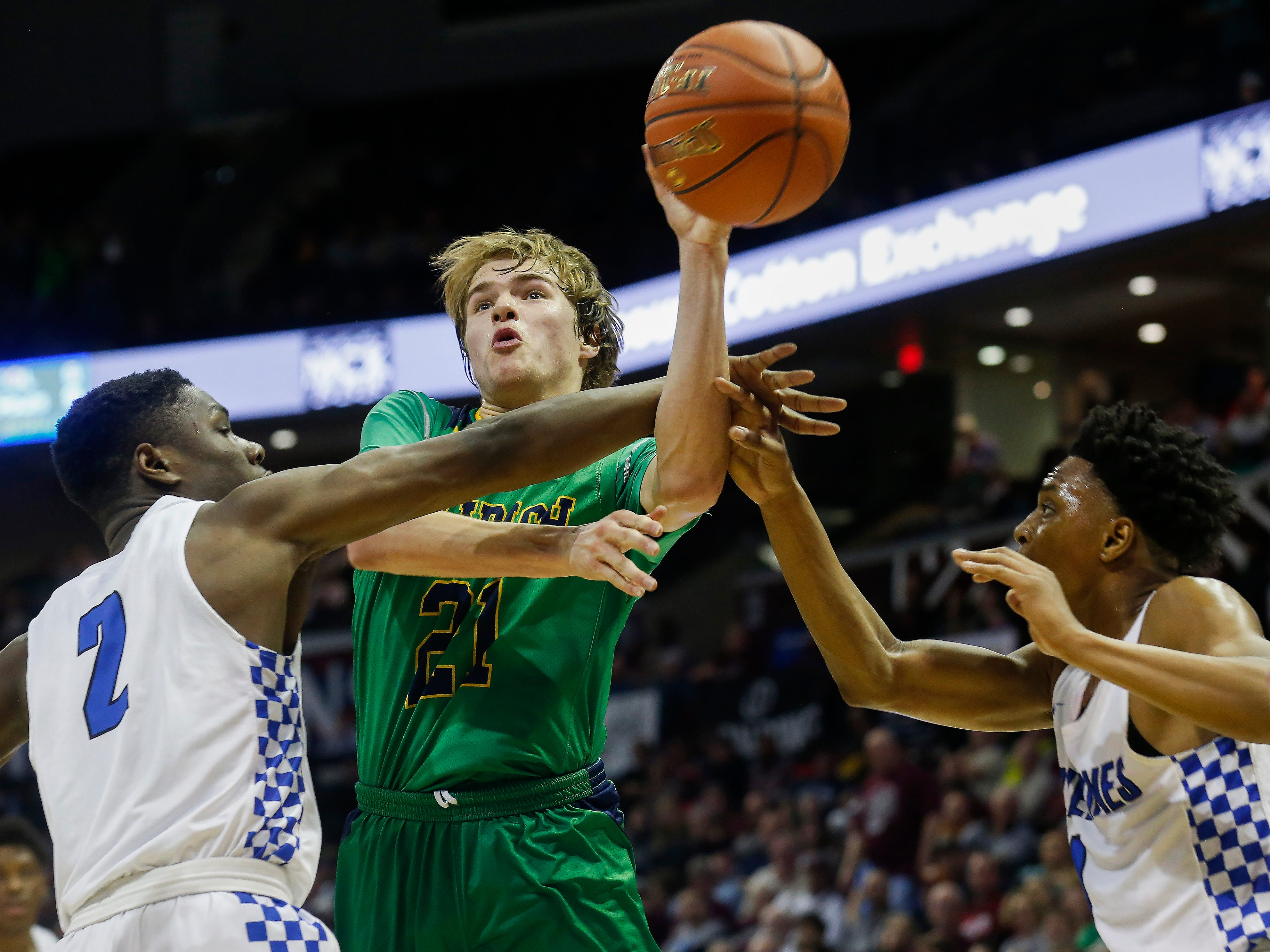 Charlie O'Reilly, of Springfield Catholic, is fouled during the Irish's 69-59 loss to Vashon in the Class 3 state championship game at JQH Arena on Friday, March 8, 2019.