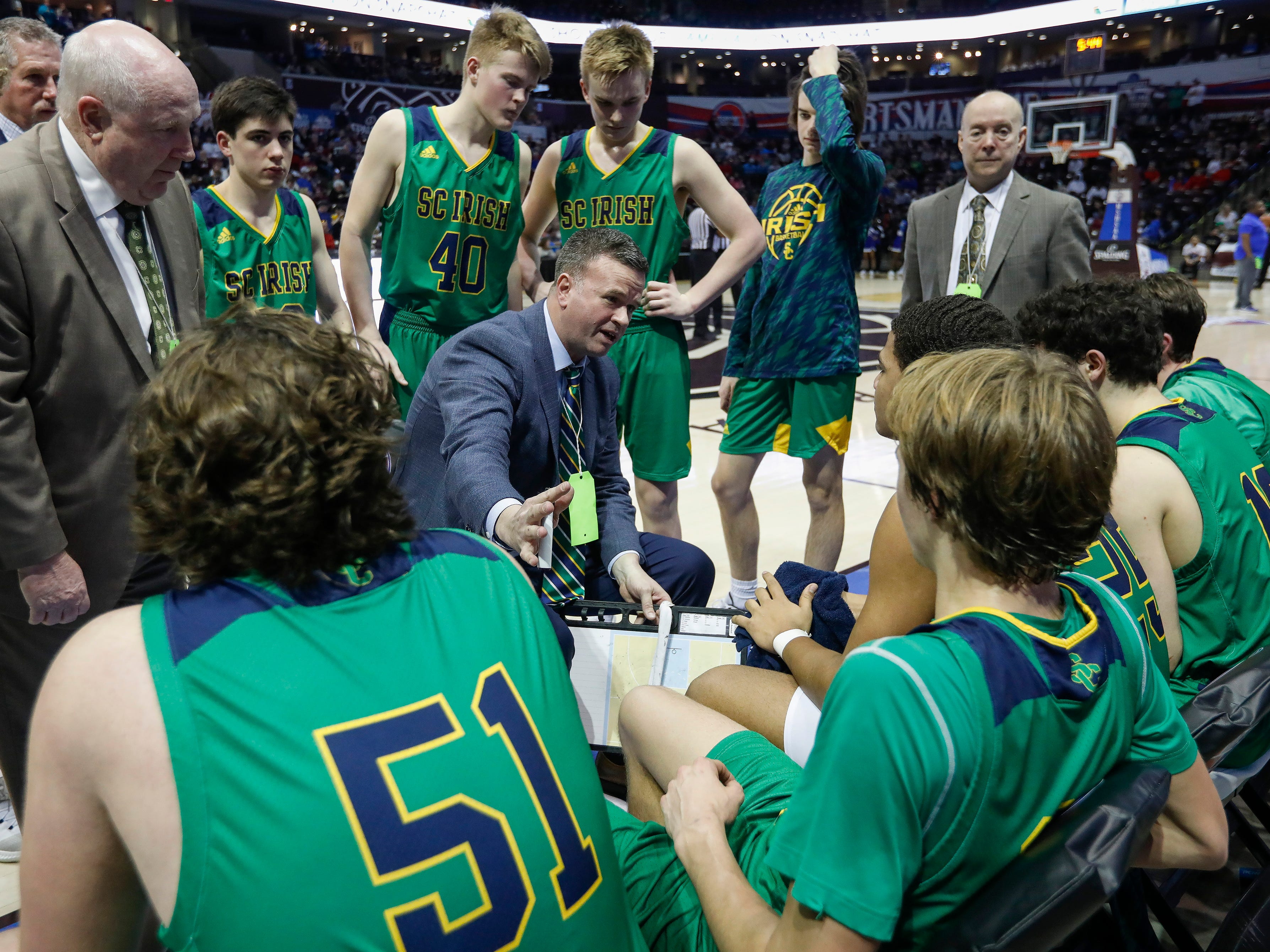 Head coach Dustin Larsen, of Springfield Catholic, talks to his team during the Irish's 69-59 loss to Vashon in the Class 3 state championship game at JQH Arena on Friday, March 8, 2019.