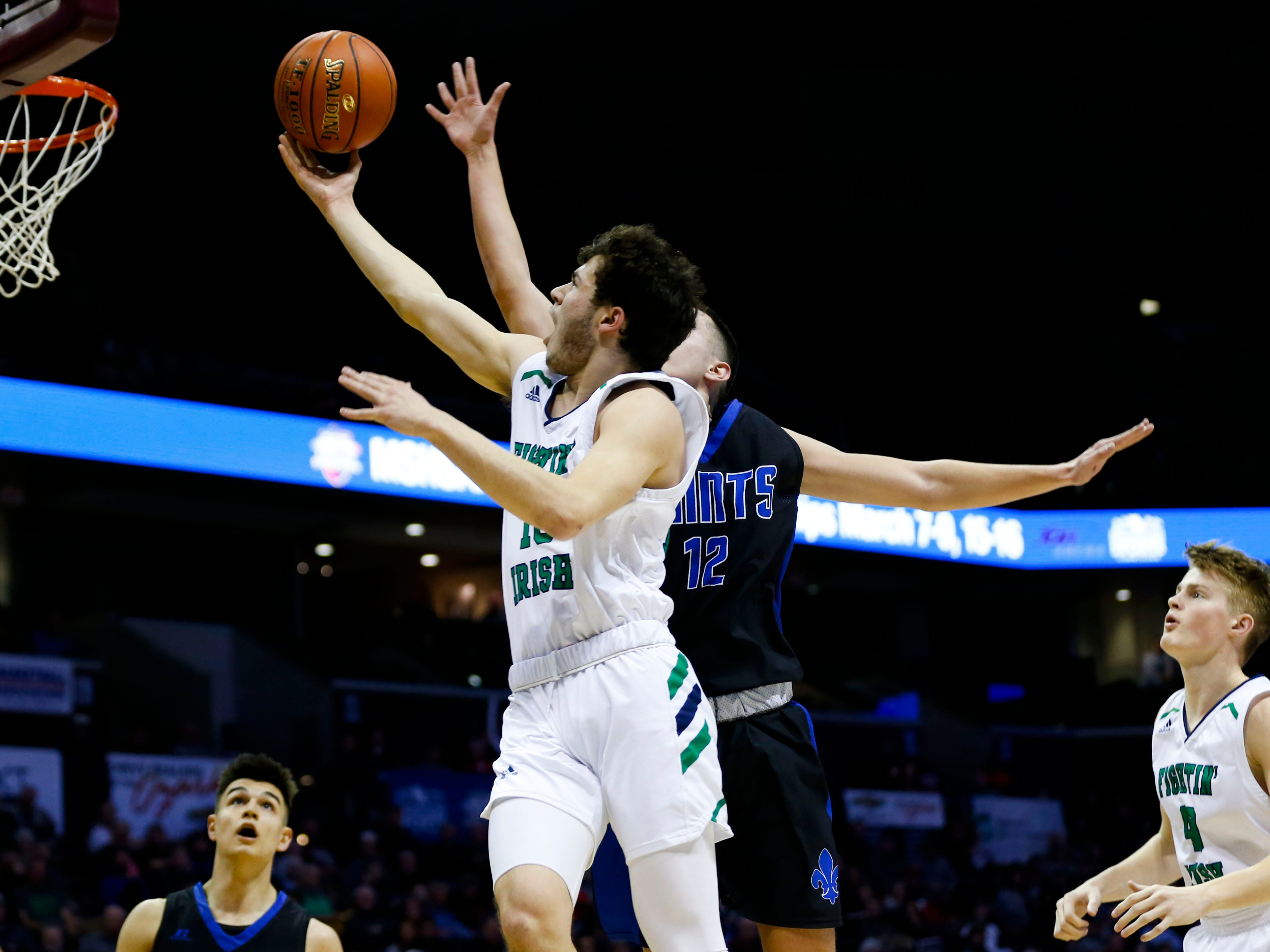 The Springfield Catholic Fightin' Irish take on the St. Paul Lutheran Saints in the semifinal round of Class 3 state basketball at JQH Arena on Thursday, March 7, 2019.