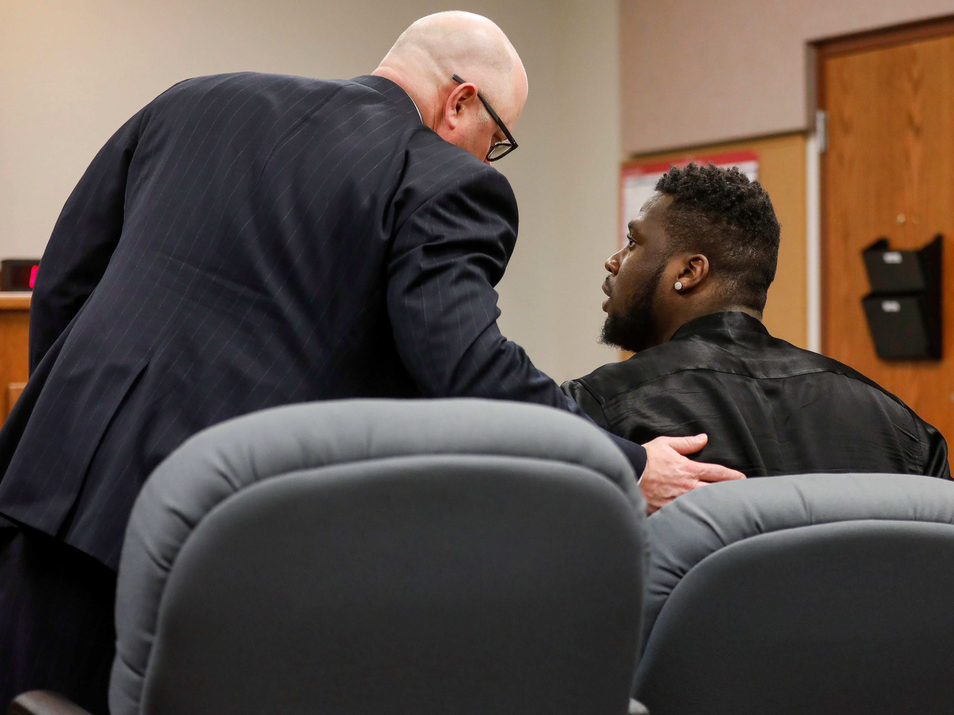 Dorial Green-Beckham's lawyer Tyson Martin, left, speaks to him after he was sentenced to 90 days in jail for probation violation in a prior DWI case on Friday, March 8, 2019.