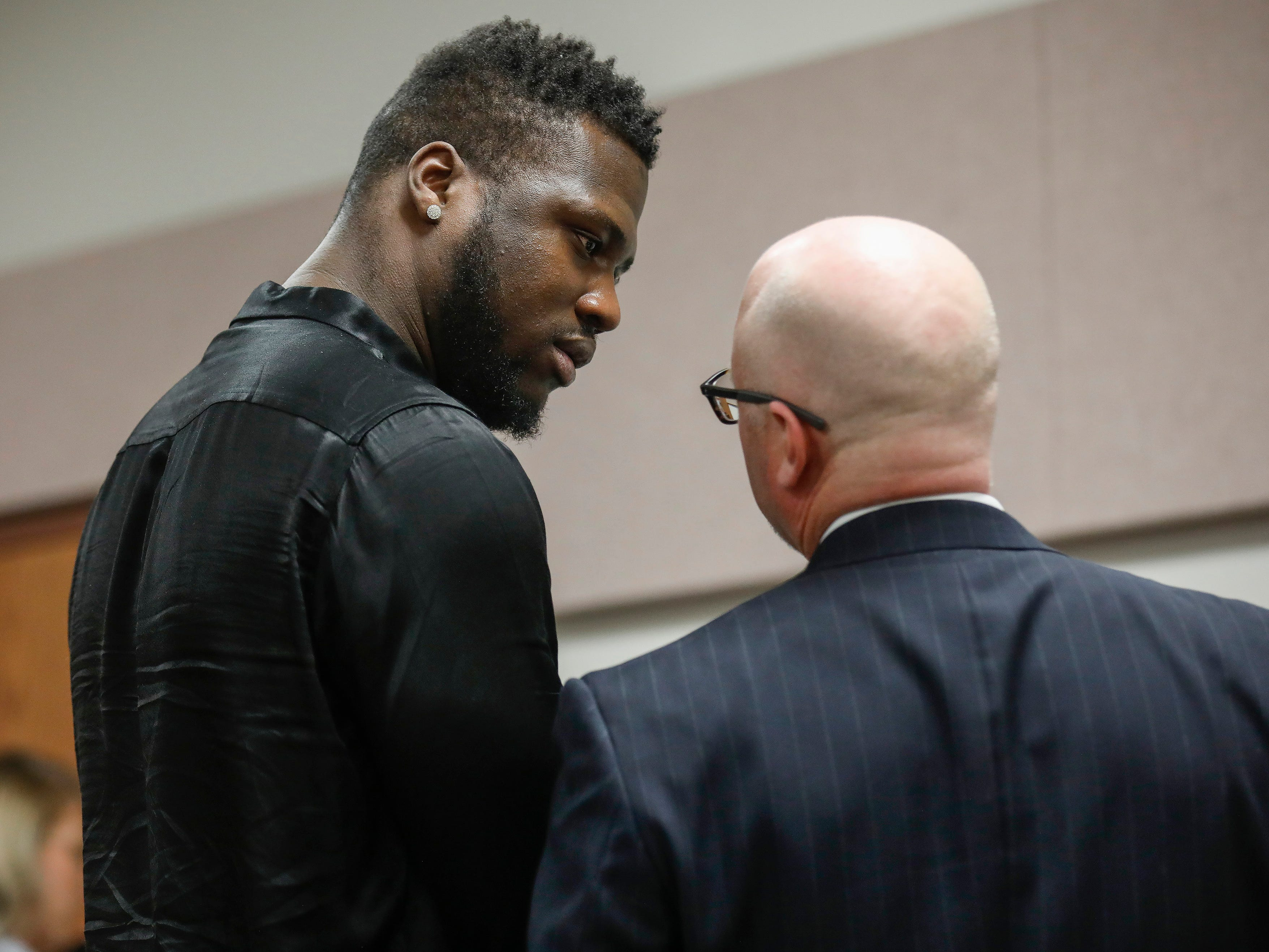 Dorial Green-Beckham's lawyer Tyson Martin, right, speaks to him after he was sentenced to 90 days in jail for probation violation in a prior DWI case on Friday, March 8, 2019.