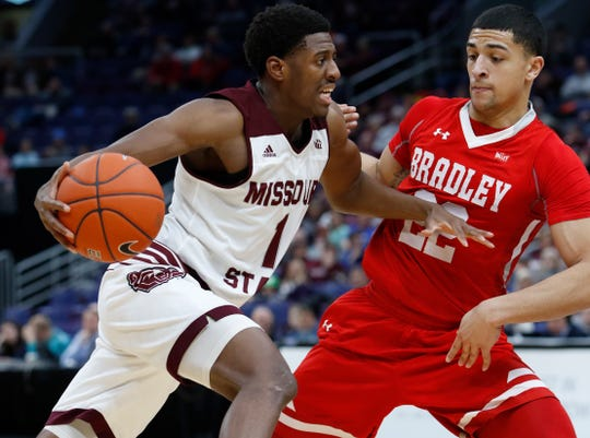 Missouri State's Keandre Cook (1) drives the ball against Bradley's Ja'Shon Henry (22), Friday, March 8, 2019, at the Enterprise Center in St. Louis.