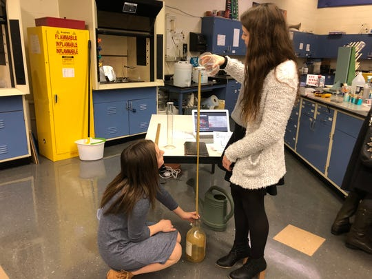 Shenandoah Valley Governor's School students Allison Kincaid and Faith Christian demonstrate an experiment at the school's 25th anniversary celebration on March 7, 2019.