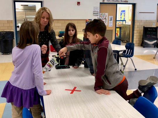 Fifth grade students at McSwain Elementary School work on a drone project to practice coding on March 7, 2019.