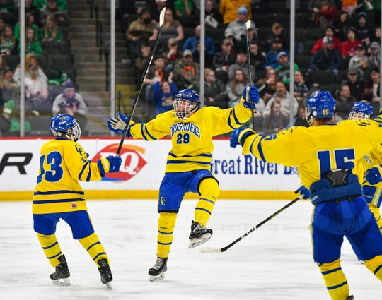 Cathedral's Jackson Savoie celebrates his goal in the third period during the 2019 state tournament championship Class A semifinals game Friday, March 8, at the Xcel Energy Center in St. Paul. Cathedral won 6-2 to advance to the Class A championship game Saturday.