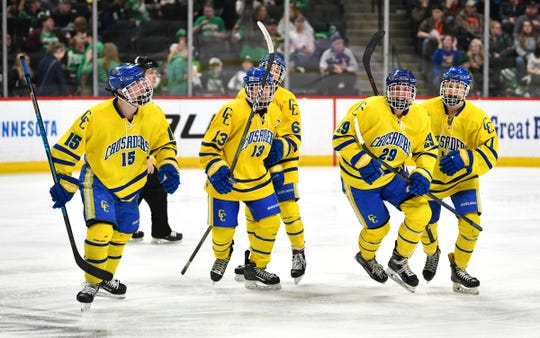 Cathedral' players celebrate a goal by Jackson Savoie during the third period of the 2019 state tournament championship semifinals game Friday, March 8, at the Xcel Energy Center in St. Paul.