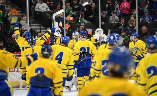 Cathedral players celebrate their 6-2 win against East Grand Forks with their goaltender Noah Amundson following the 2019 state tournament  semifinals game Friday, March 8, at the Xcel Energy Center in St. Paul.