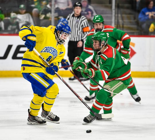 Cathedral's Nate Warner advances with the puck during the 2019 state tournament championship semifinals game Friday, March 8, at the Xcel Energy Center in St. Paul.