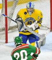 Cathedral's Noah Amundson makes a save during the 2019 state tournament championship semifinals game against East Grand Forks Friday, March 8, at the Xcel Energy Center in St. Paul.