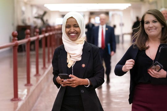 """Rep. Ilhan Omar, D-Minn., walks to the chamber Thursday, March 7, on Capitol Hill in Washington, as the House was preparing to vote on a resolution to speak out against, as Speaker of the House Nancy Pelosi said, """"anti-Semitism, anti-Islamophobia, anti-white supremacy and all the forms that it takes,"""" an action sparked by remarks from Omar."""