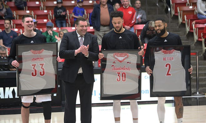 (From left to right) Matthew Johnson, coach Todd Simon, Elijah Graves and Brandon Better take part in senior day celebrations before Thursday's game against Northern Colorado.