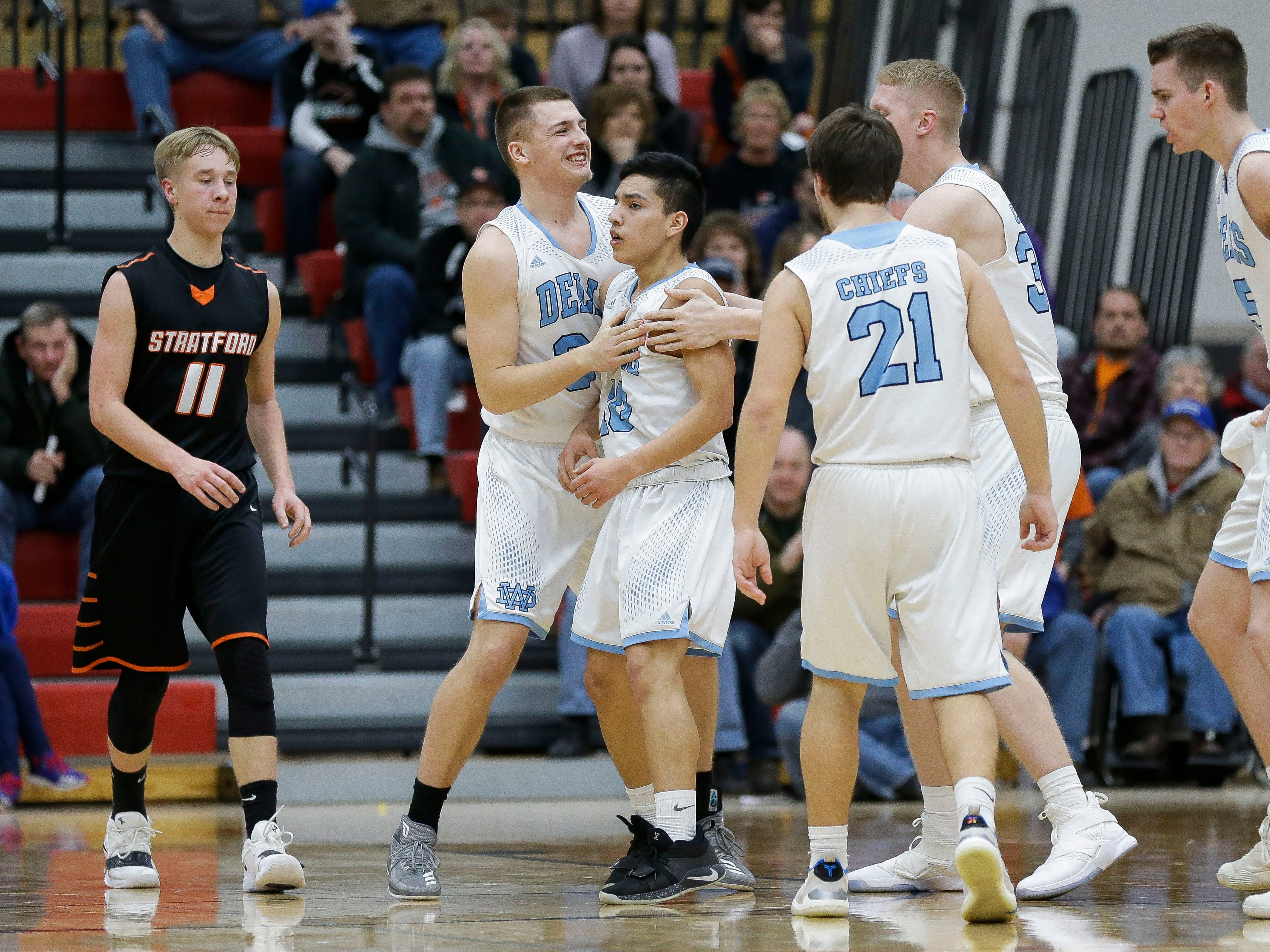 Wisconsin Dells' Bryson Funmaker (10) celebrates with his teammates after hitting a 3-pointer against Stratford in a Division 3 sectional semifinal on Thursday, March 7, 2019, at Stevens Point Area High School in Stevens Point, Wis. Tork Mason/USA TODAY NETWORK-Wisconsin
