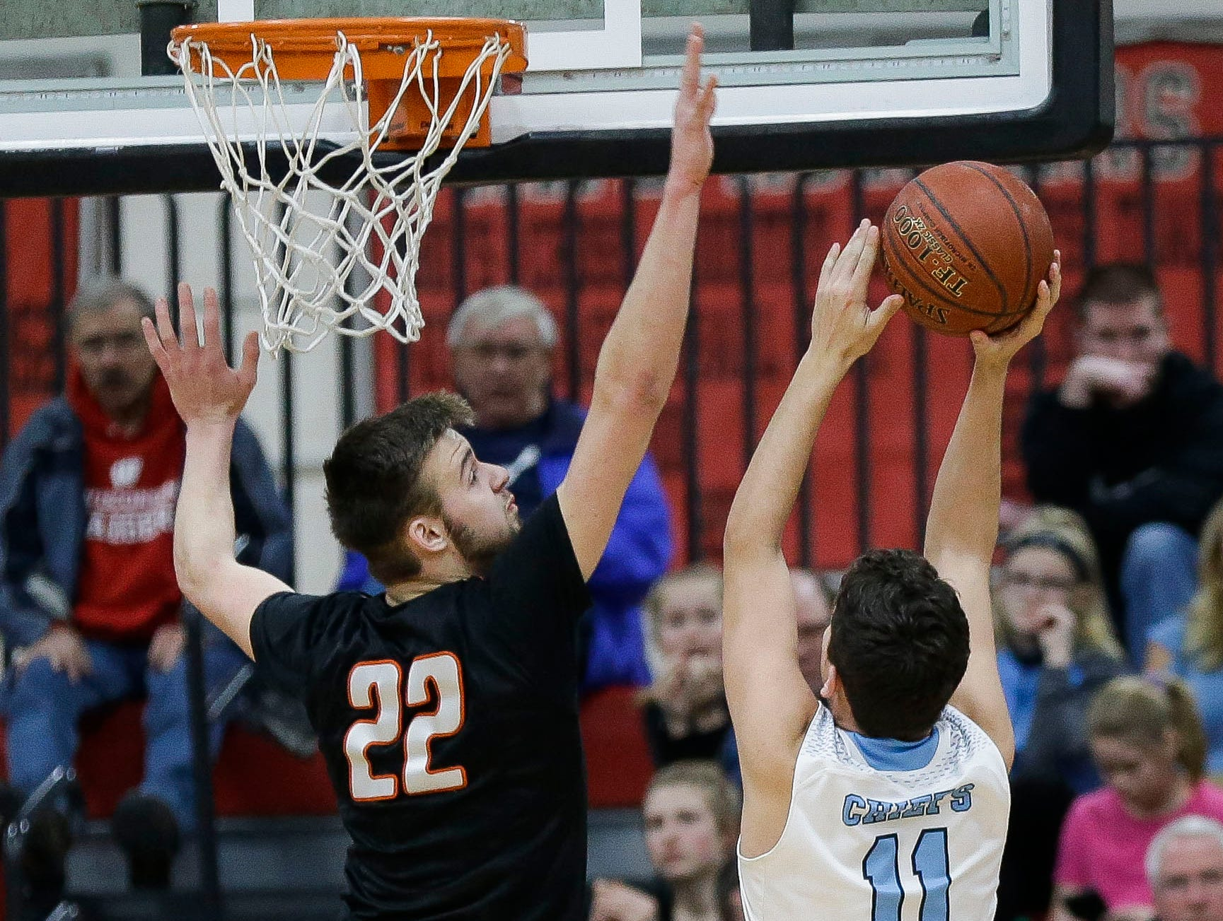 Stratford's Vaughn Breit (22) blocks the shot of Wisconsin Dells' Riley Eck (11) in a Division 3 sectional semifinal on Thursday, March 7, 2019, at Stevens Point Area High School in Stevens Point, Wis. Tork Mason/USA TODAY NETWORK-Wisconsin
