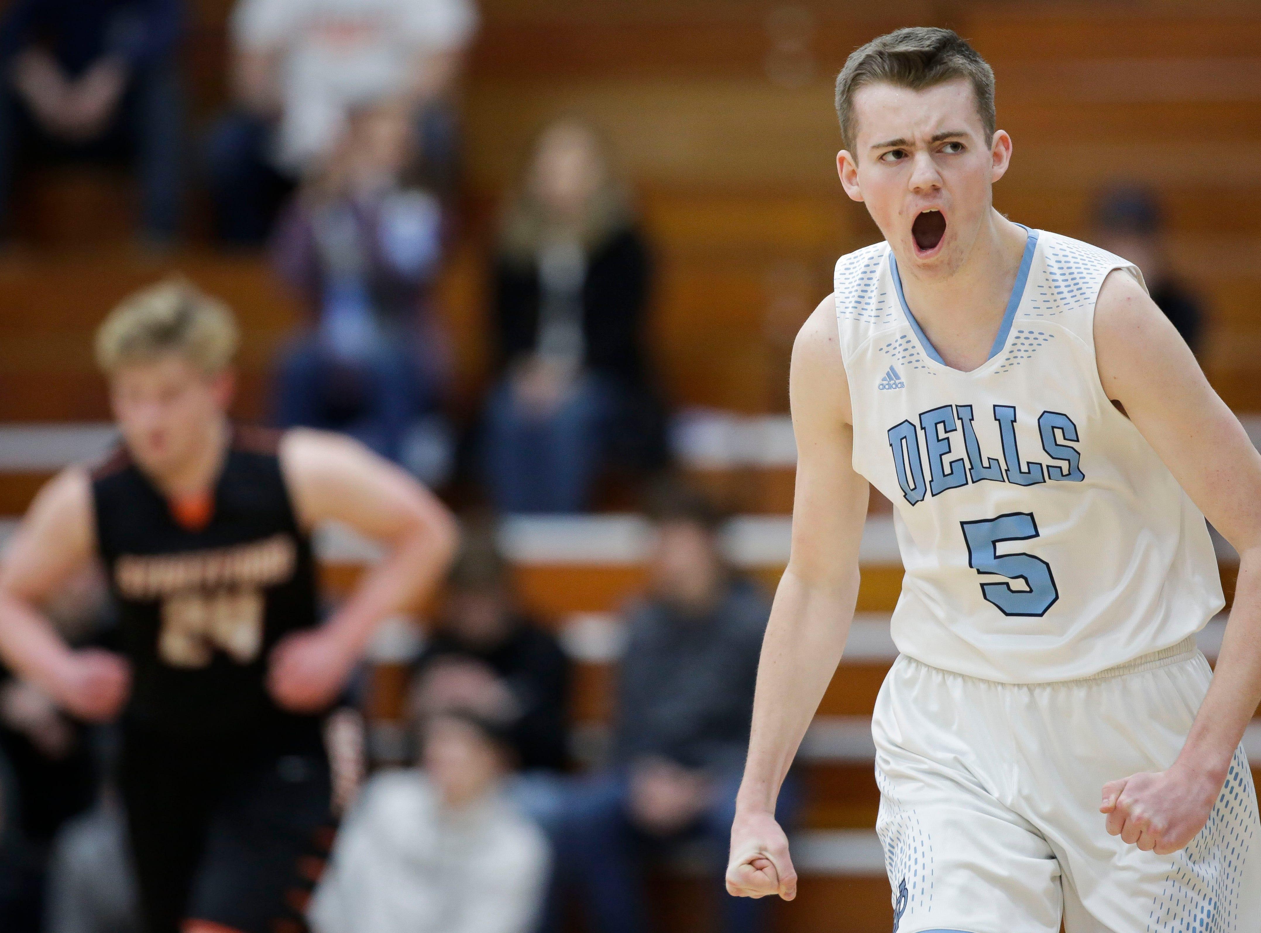 Wisconsin Dells' Sam Millard (5) reacts after hitting a 3-pointer against Stratford in a Division 3 sectional semifinal on Thursday, March 7, 2019, at Stevens Point Area High School in Stevens Point, Wis. Tork Mason/USA TODAY NETWORK-Wisconsin