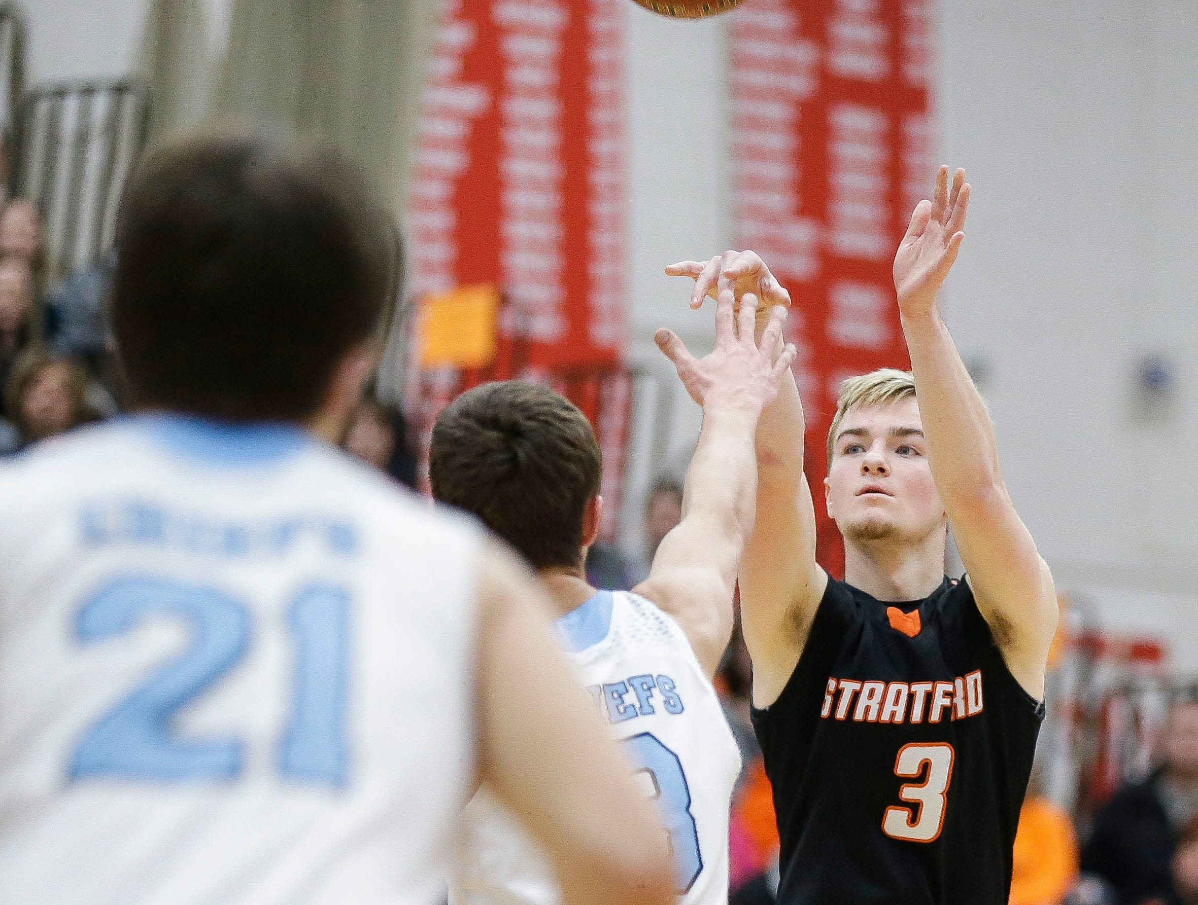 Stratford's Okley Wrensch (3) shoots a 3-pointer against Wisconsin Dells in a Division 3 sectional semifinal on Thursday, March 7, 2019, at Stevens Point Area High School in Stevens Point, Wis. Tork Mason/USA TODAY NETWORK-Wisconsin