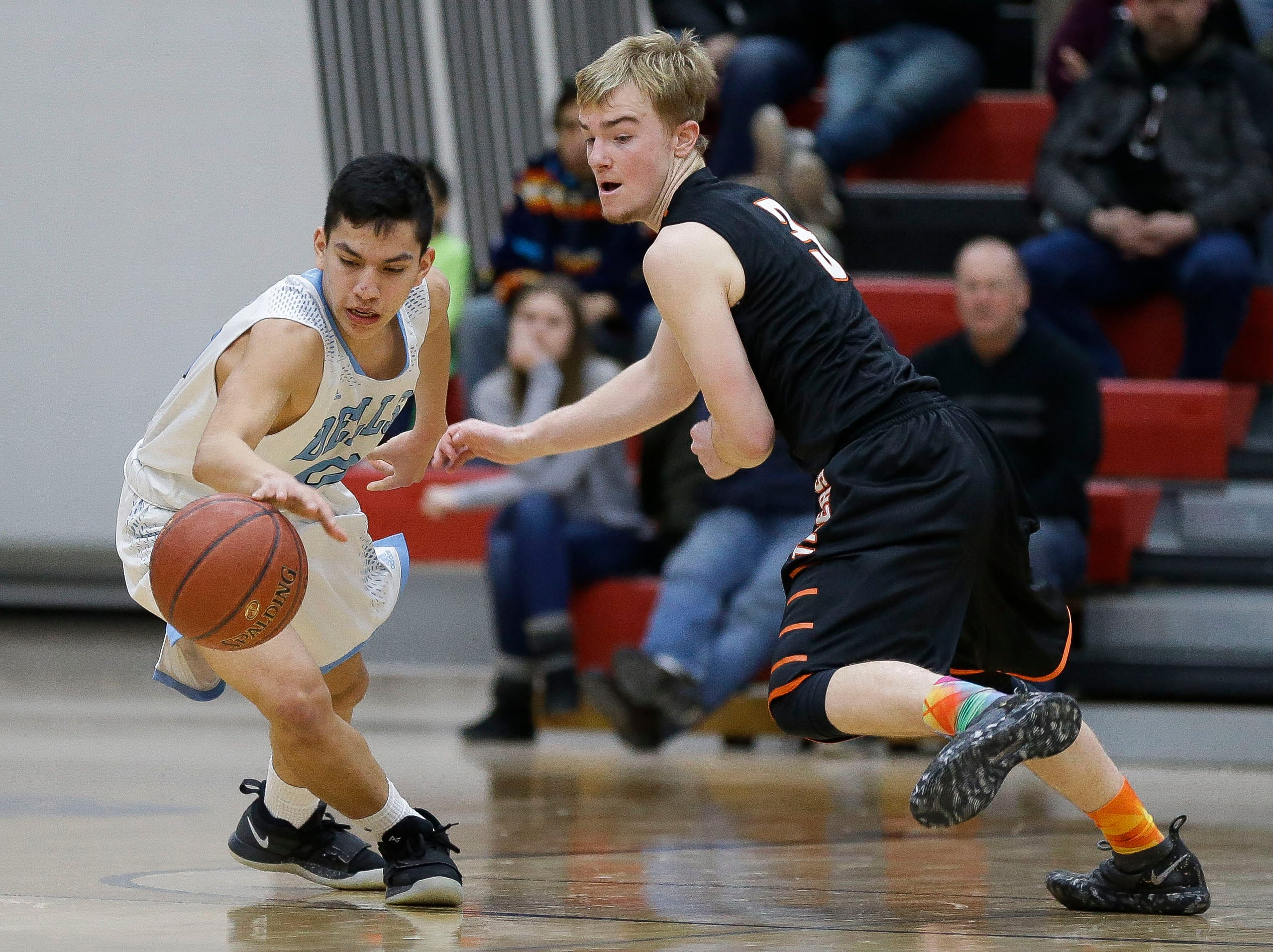 Stratford's Okley Wrensch (3) defends Wisconsin Dells' Bryson Funmaker (10) in a Division 3 sectional semifinal on Thursday, March 7, 2019, at Stevens Point Area High School in Stevens Point, Wis. Tork Mason/USA TODAY NETWORK-Wisconsin