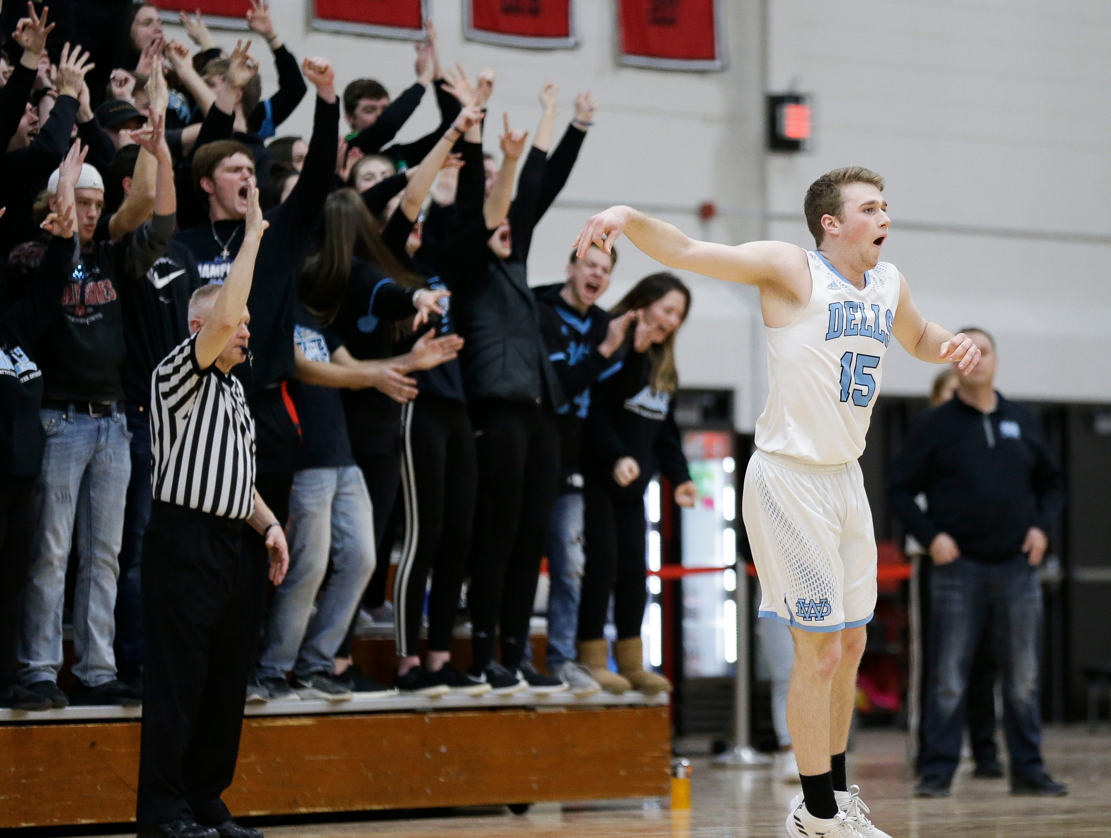 Wisconsin Dells' Dylan Anchor (15) reacts after hitting a 3-pointer against Stratford in a Division 3 sectional semifinal on Thursday, March 7, 2019, at Stevens Point Area High School in Stevens Point, Wis. Tork Mason/USA TODAY NETWORK-Wisconsin