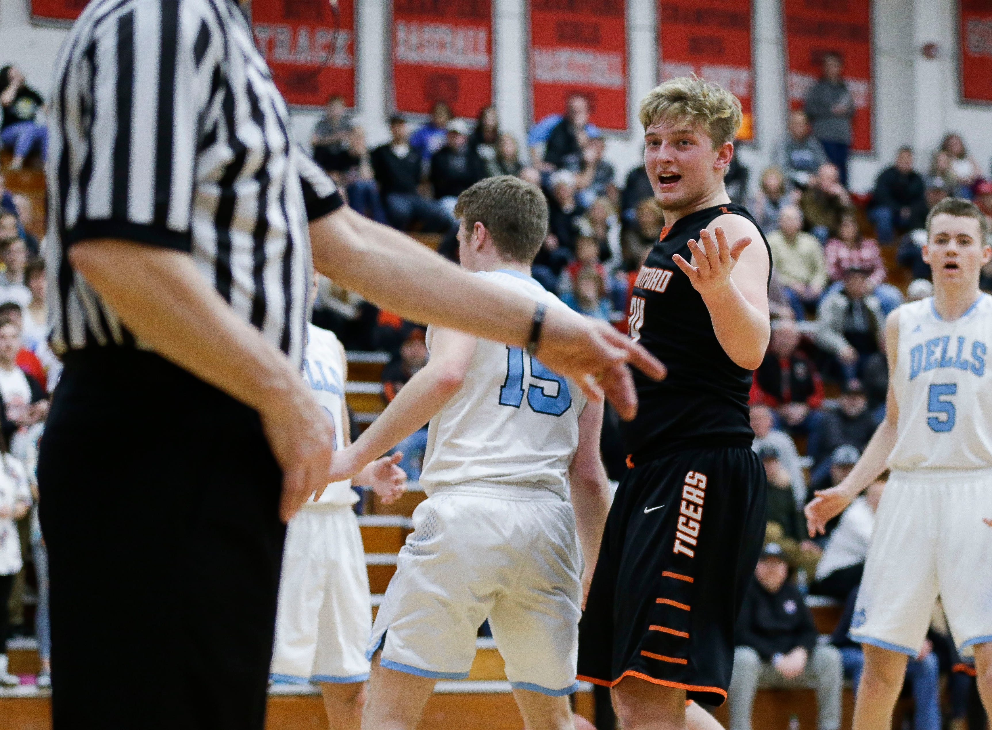 Stratford's Ben Barten (24) reacts to being called for a foul against Wisconsin Dells in a Division 3 sectional semifinal on Thursday, March 7, 2019, at Stevens Point Area High School in Stevens Point, Wis.  Tork Mason/USA TODAY NETWORK-Wisconsin