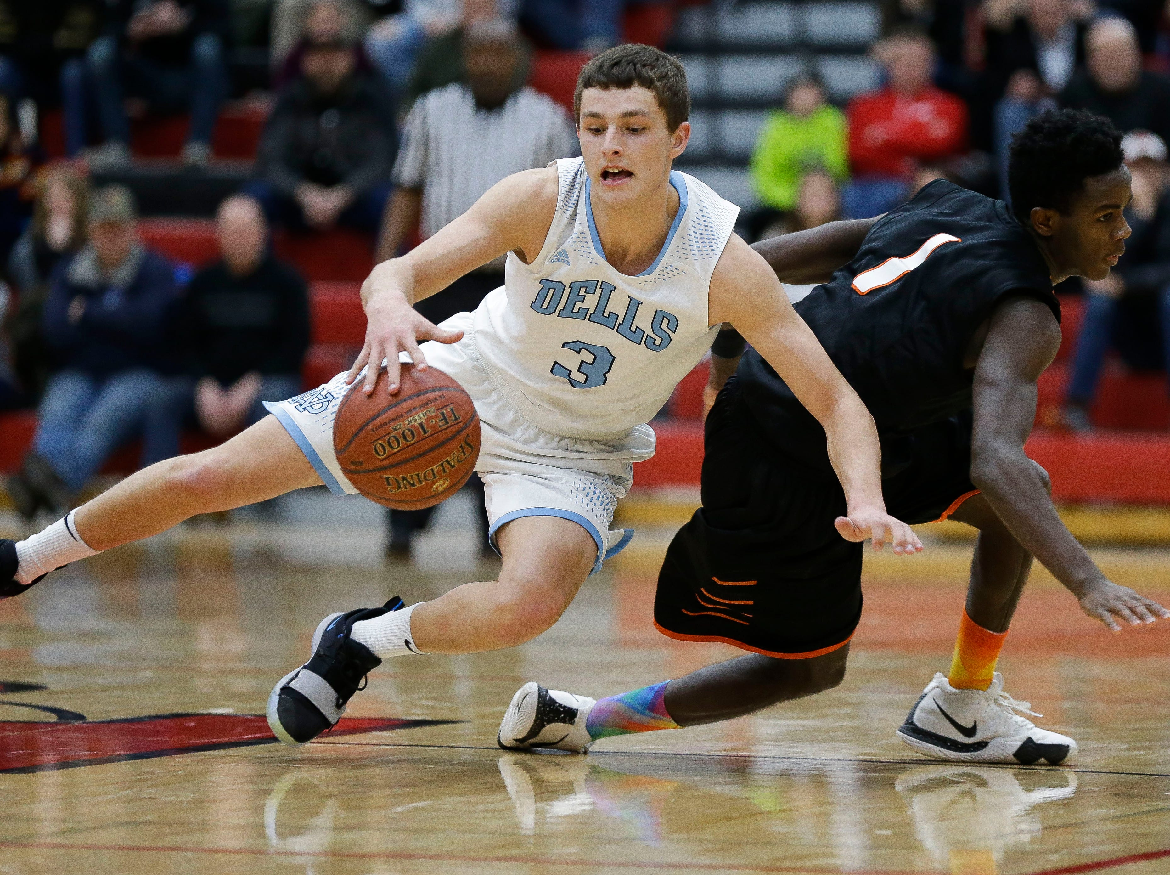 Wisconsin Dells' Brett Hirst (3) keeps his dribble as he falls to the floor against Stratford in a Division 3 sectional semifinal on Thursday, March 7, 2019, at Stevens Point Area High School in Stevens Point, Wis. Tork Mason/USA TODAY NETWORK-Wisconsin