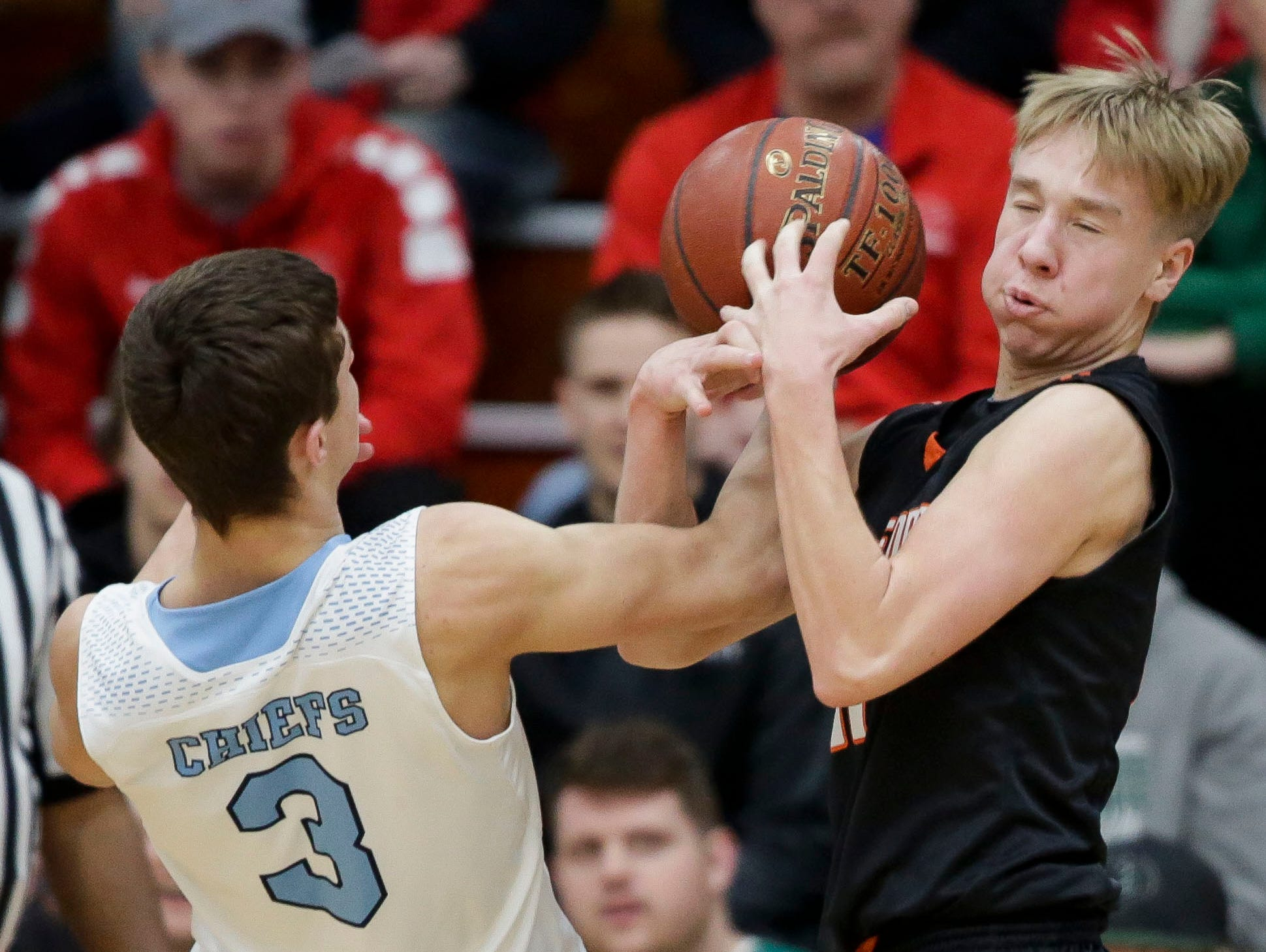 Stratford's Chandler Schmidt (11) grabs a rebound against Wisconsin Dells in a Division 3 sectional semifinal on Thursday, March 7, 2019, at Stevens Point Area High School in Stevens Point, Wis. Tork Mason/USA TODAY NETWORK-Wisconsin