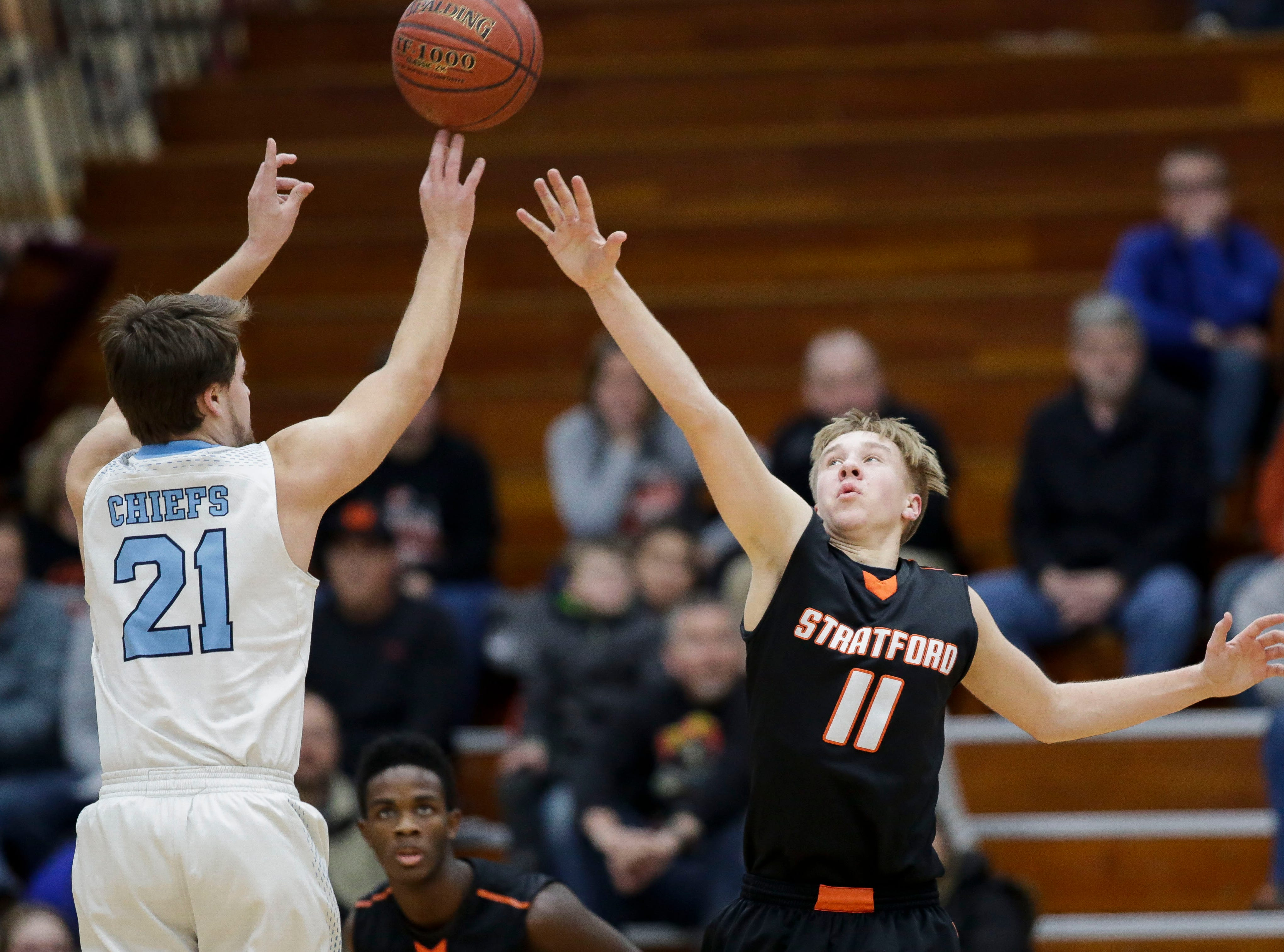 Stratford's Chandler Schmidt (11) contests a shot against Wisconsin Dells in a Division 3 sectional semifinal on Thursday, March 7, 2019, at Stevens Point Area High School in Stevens Point, Wis. Tork Mason/USA TODAY NETWORK-Wisconsin