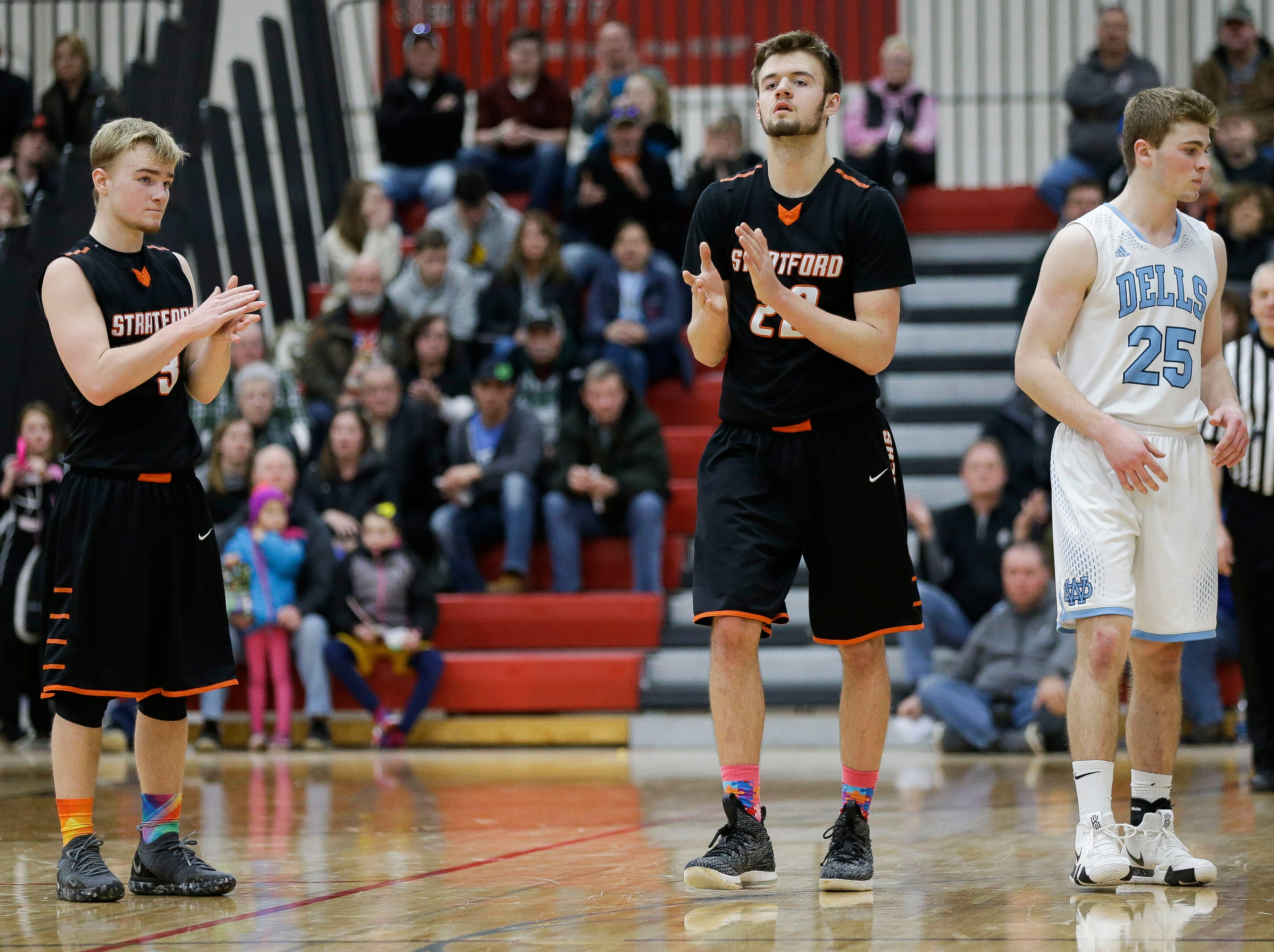 Stratford's Okley Wrensch (3) and Vaughn Breit (22) react after a Wisconsin Dells turnover in a Division 3 sectional semifinal on Thursday, March 7, 2019, at Stevens Point Area High School in Stevens Point, Wis. Tork Mason/USA TODAY NETWORK-Wisconsin