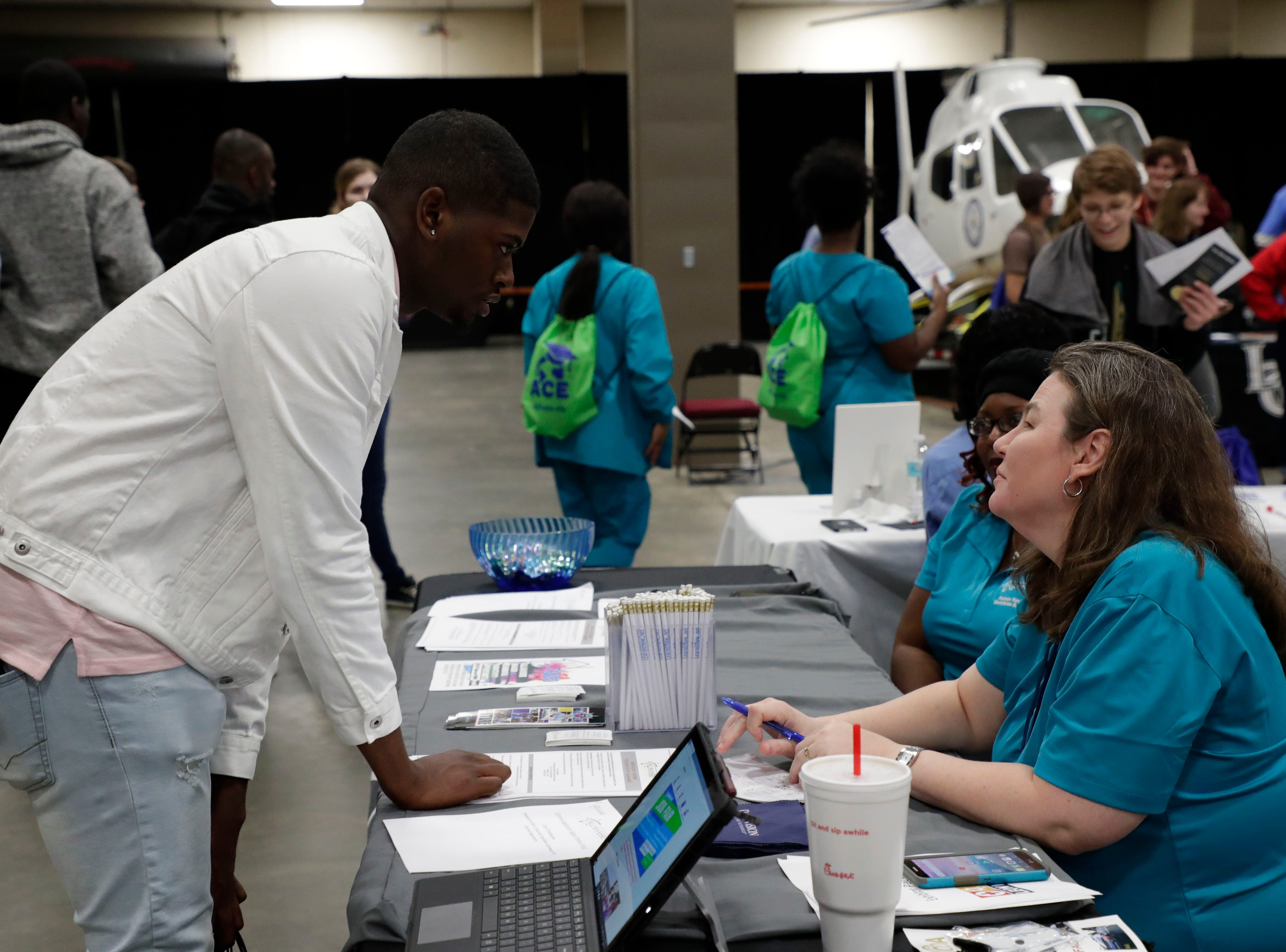 Donte Jackson, a senior at Rickards High School, talks with Kelly Perkins, a Human Resources information analyst with the City of Tallahassee. High school students throughout Leon County attended the Leon Works Expo at the Tucker Civic Center Friday March 8, 2019.