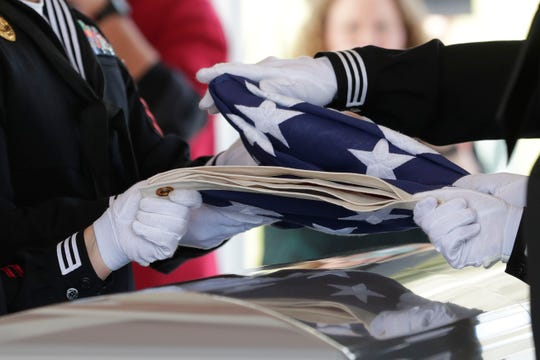 Members of the Naval Operational Support Center of Tallahassee fold the flag from which was draped on the casket of Earl Paul Baum, a sailor who was killed in Pearl Harbor. A funeral was held at the Tallahassee National Cemetery honoring Baum Friday, March 8, 2019.