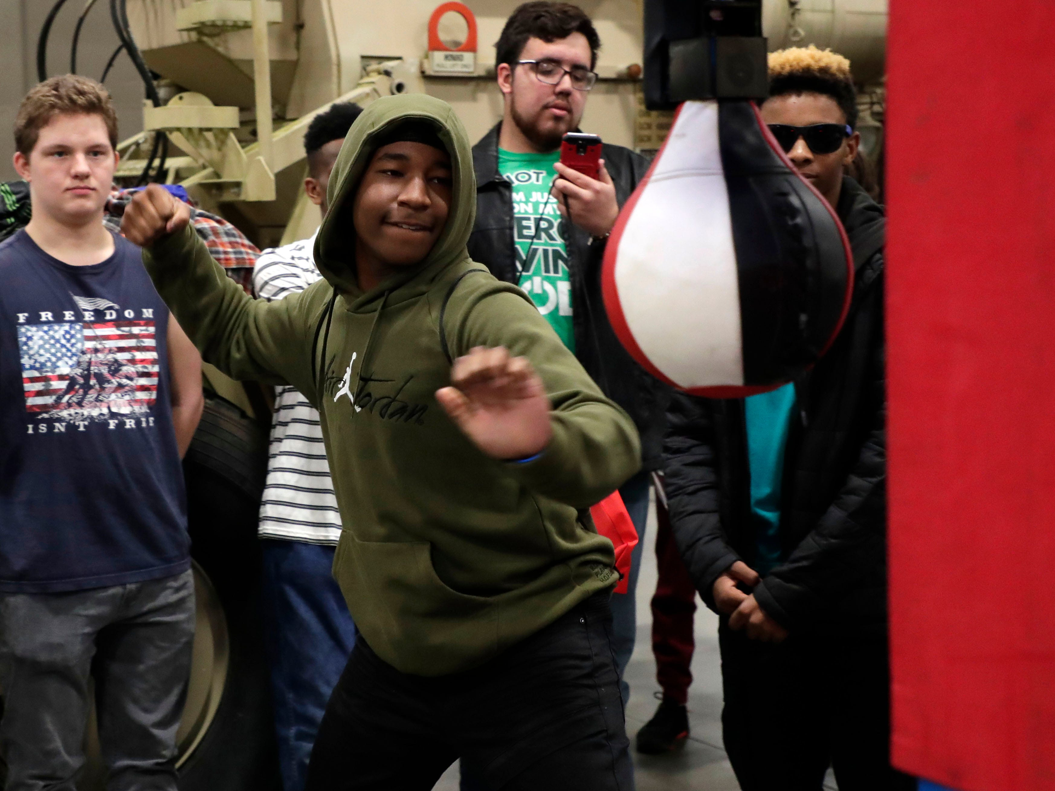 Trenton Everett sees how hard he can pack a punch at the National Guard booth. High school students throughout Leon County attended the Leon Works Expo at the Tucker Civic Center Friday March 8, 2019.