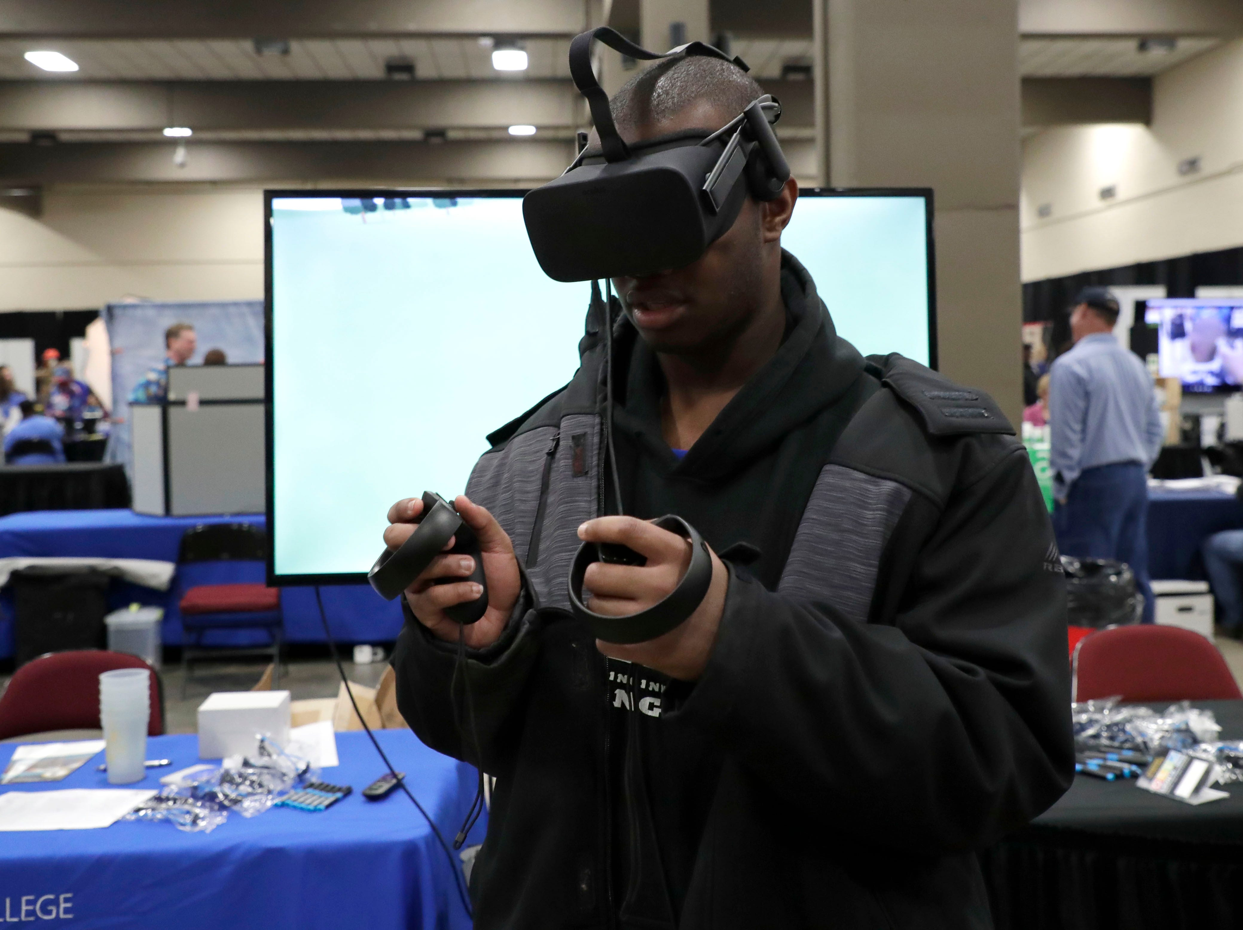 Javon Hall tries out a virtual reality game presented by the business industry and technology department at Tallahassee Community College. High school students throughout Leon County attended the Leon Works Expo at the Tucker Civic Center Friday March 8, 2019.