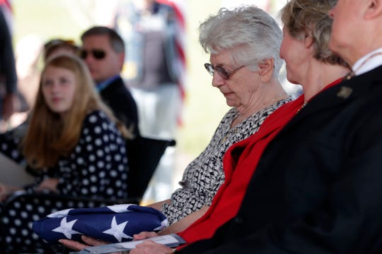 Emily Golz, sister of Earl Paul Baum, a sailor who was killed in Pearl Harbor, looks down at the folded American flag from the casket of her brother.  A funeral was held at the Tallahassee National Cemetery honoring Baum Friday, March 8, 2019.