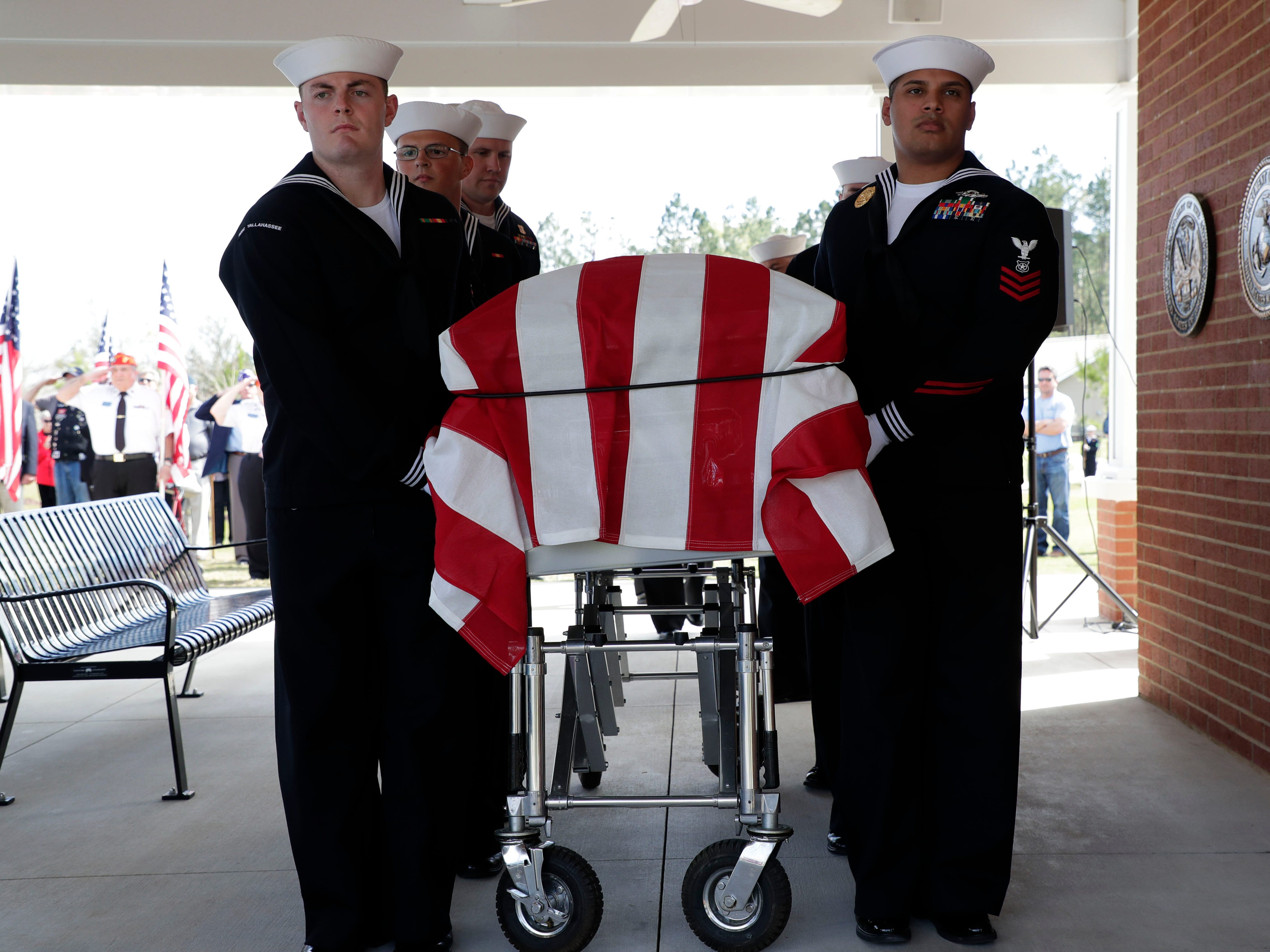 Members of Navy Operational Support Center Tallahassee carry the casket of Earl Baum, a sailor who was killed in Pearl Harbor. A funeral was held at the Tallahassee National Cemetery honoring Baum Friday, March 8, 2019.