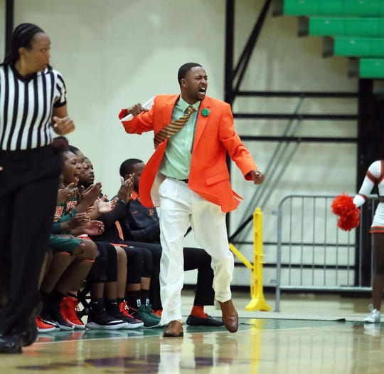 FAMU women's basketball Kevin Lynum cheers on the Rattlers after scoring a basket against Savannah State.