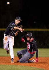 Jensen Beach second baseman Jeremy Galinis (top) forces Ben Yurigan out at second base after Vero Beach's CJ Auger nearly hits into a double play, but is safe at first base, during the fifth inning of the high school baseball game Thursday, March 7, 2019, at Jensen Beach High School.