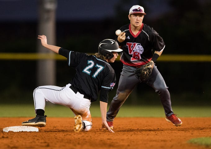 Vero Beach shortstop Nick Dean bobbles the ball after tagging out Jensen Beach's Austin Trumpour as he tries to steal second base, ending the second inning, during the high school baseball game Thursday, March 7, 2019, at Jensen Beach High School.