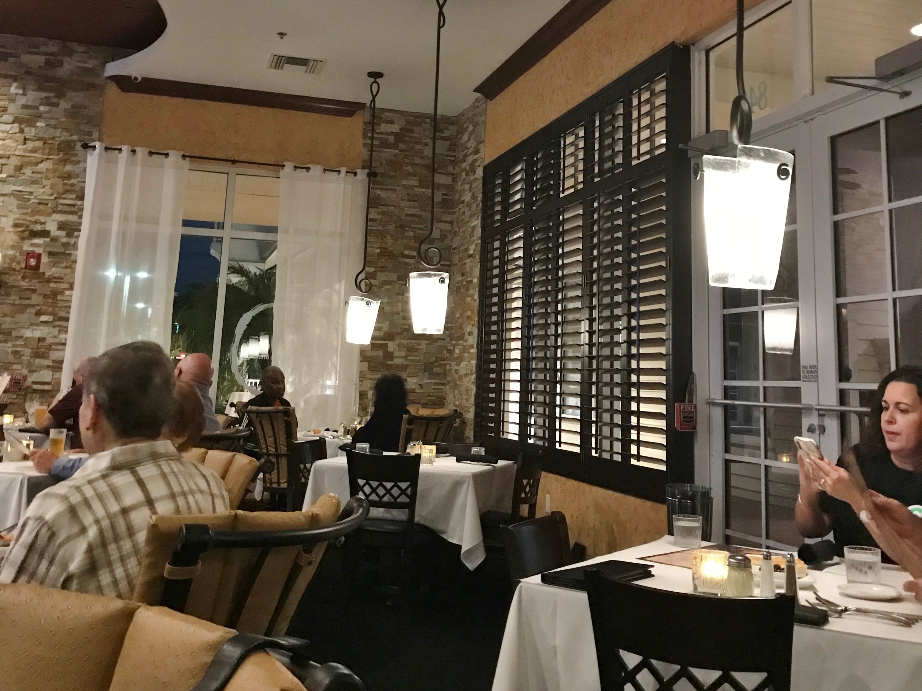 Mamma Mia Osteria has high ceilings and rustic stone walls.