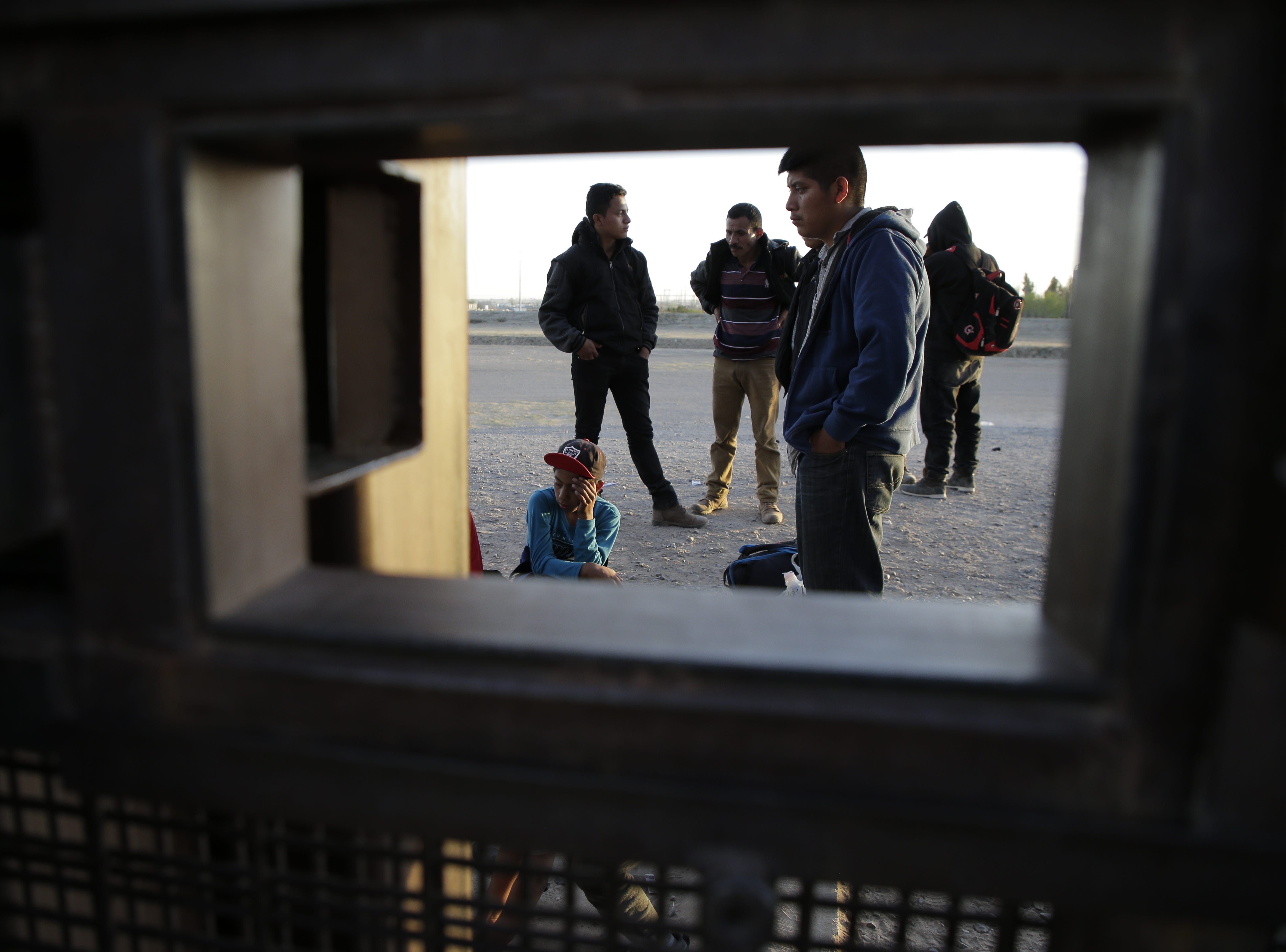 Migrants from Guatemala await Border Patrol at the U.S.-Mexico border in El Paso, Texas.