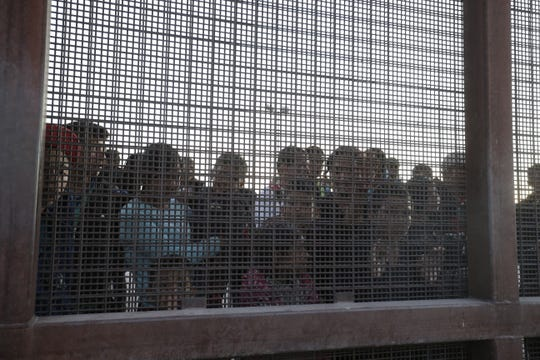 A group of 60 migrants from Guatemala awaited Border Patrol at a border in El Paso, Texas.