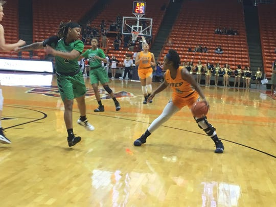 UTEP's Neidy Ocuane looks for space against the defense of North Texas' Callie Owens Thursday night at the Don Haskins Center