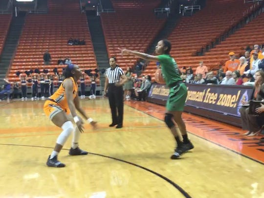 North Texas' Terriel Bradley directs traffic against the defense of UTEP's Jordan Alexander Thursday night at the Don Haskins Center